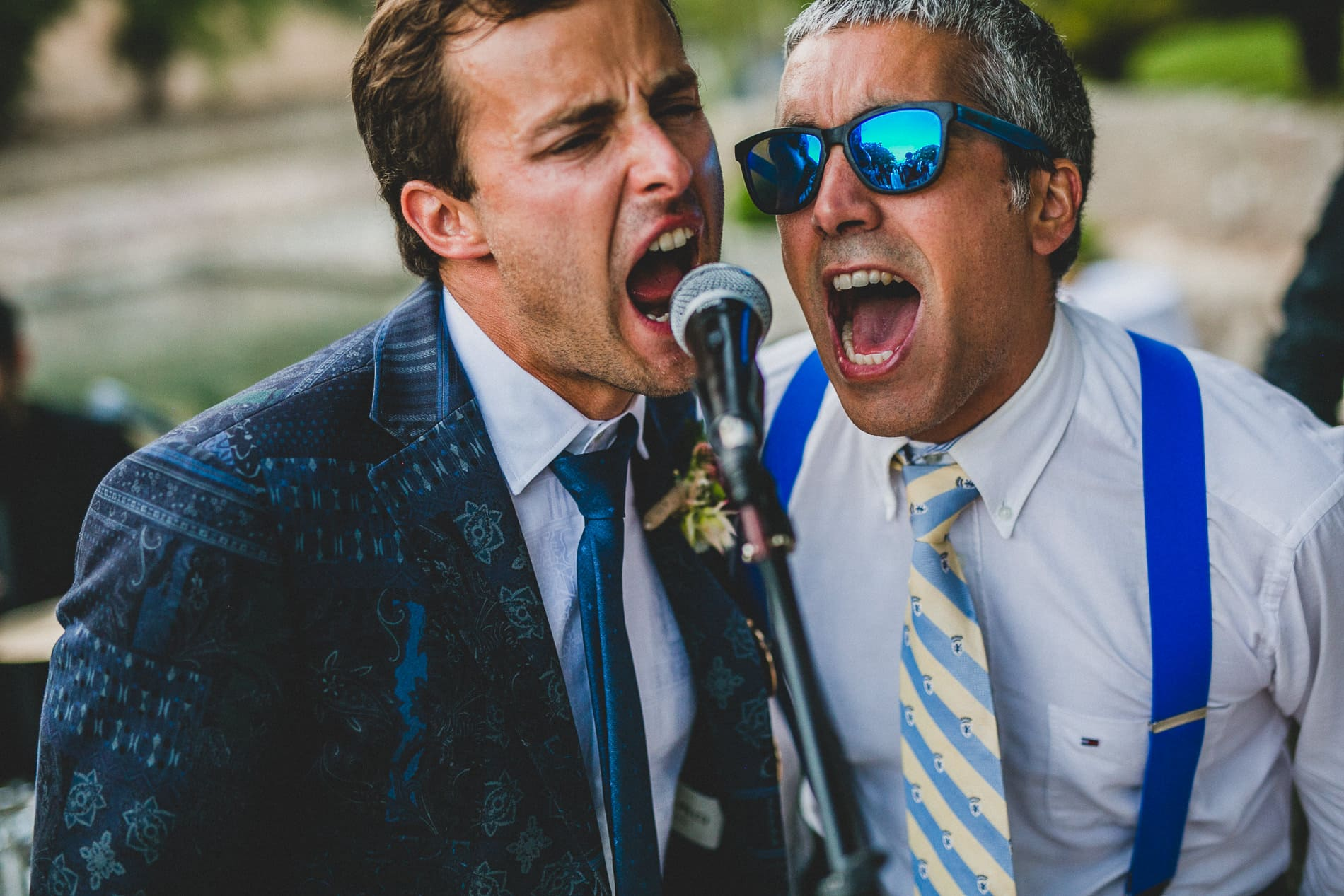 groom and best man singing out loud