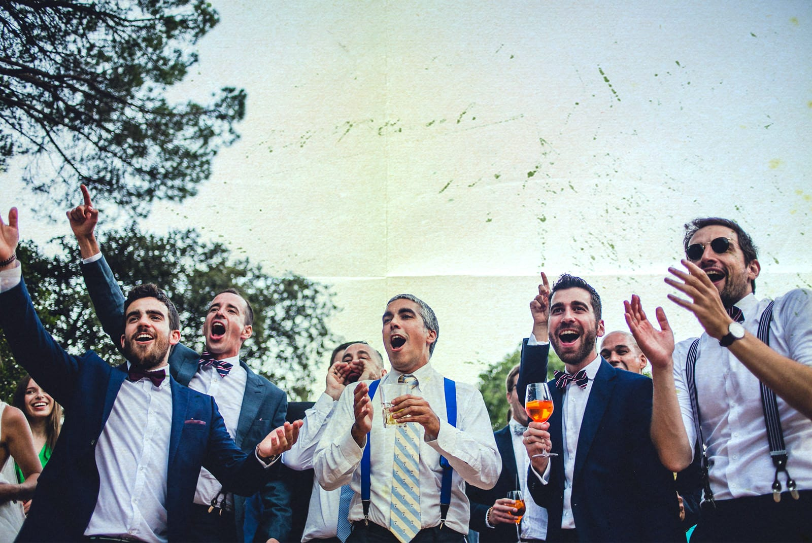 groom jumping and singing with his friends