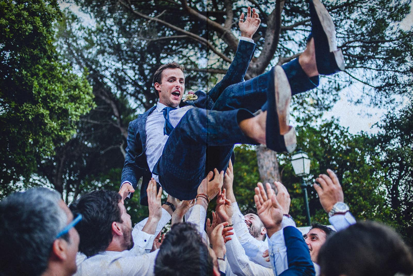 groom is thrown into the air