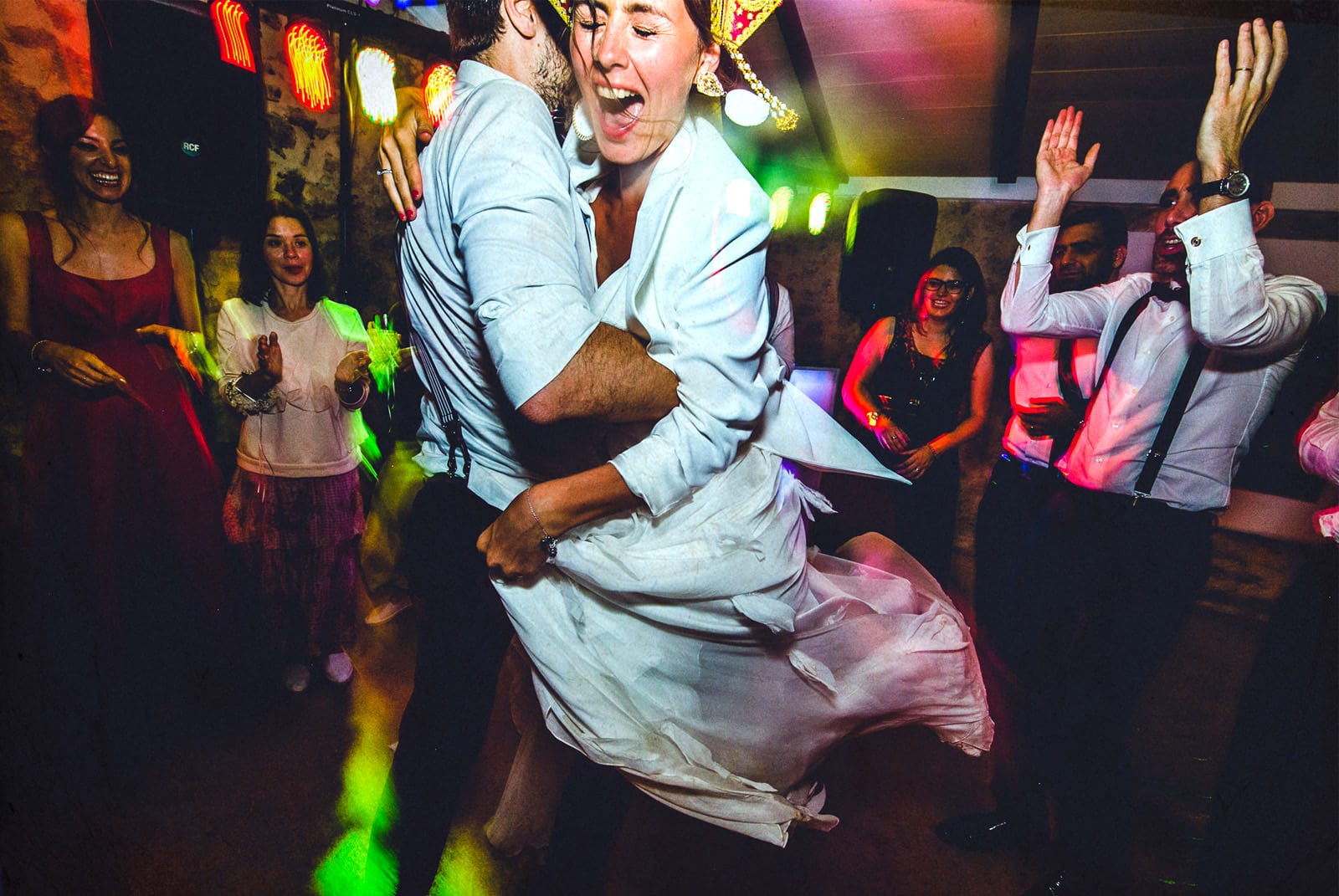 bride screaming while a man spins her on the dance floor