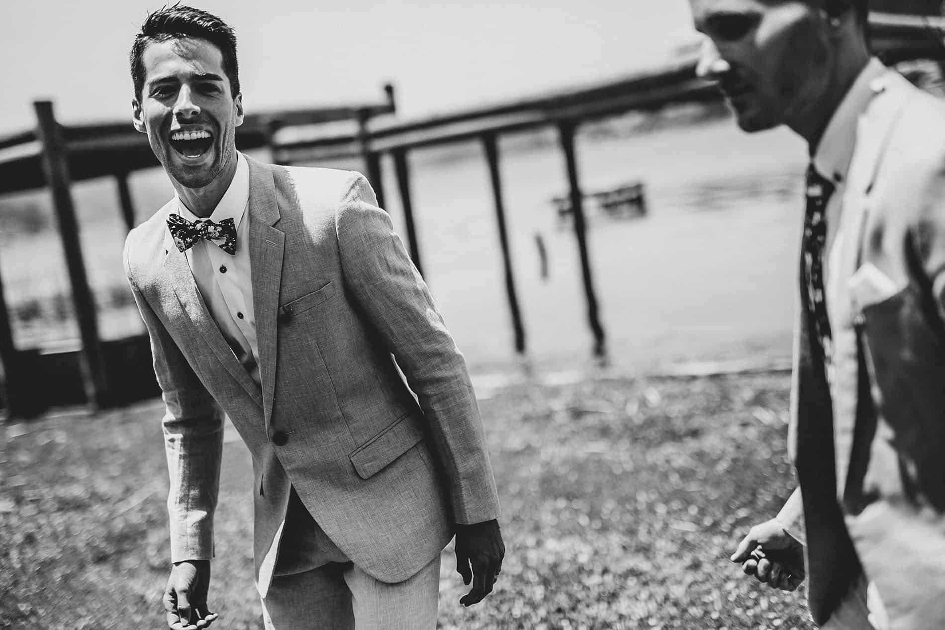 grooms laughing before the ceremony