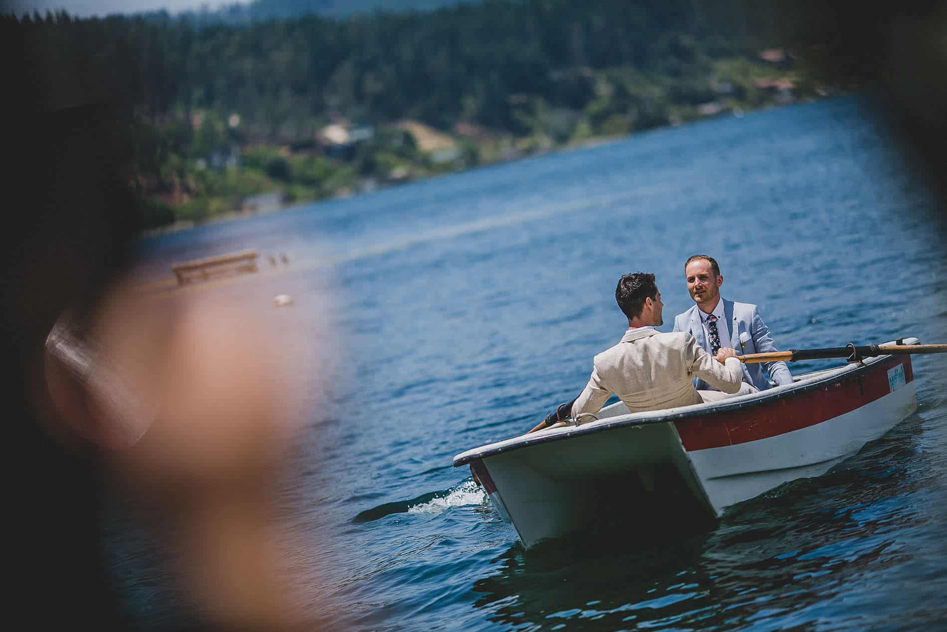 grooms going to the ceremony in a boat