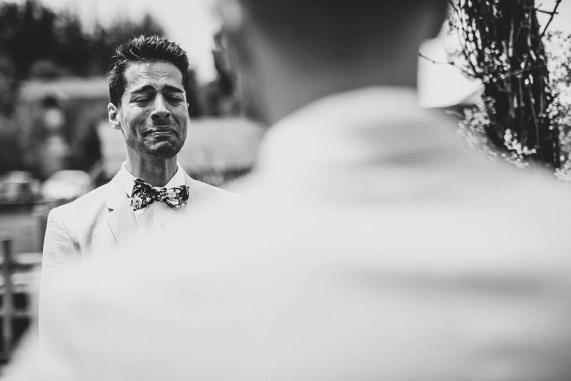 groom crying while he listening the wedding vows