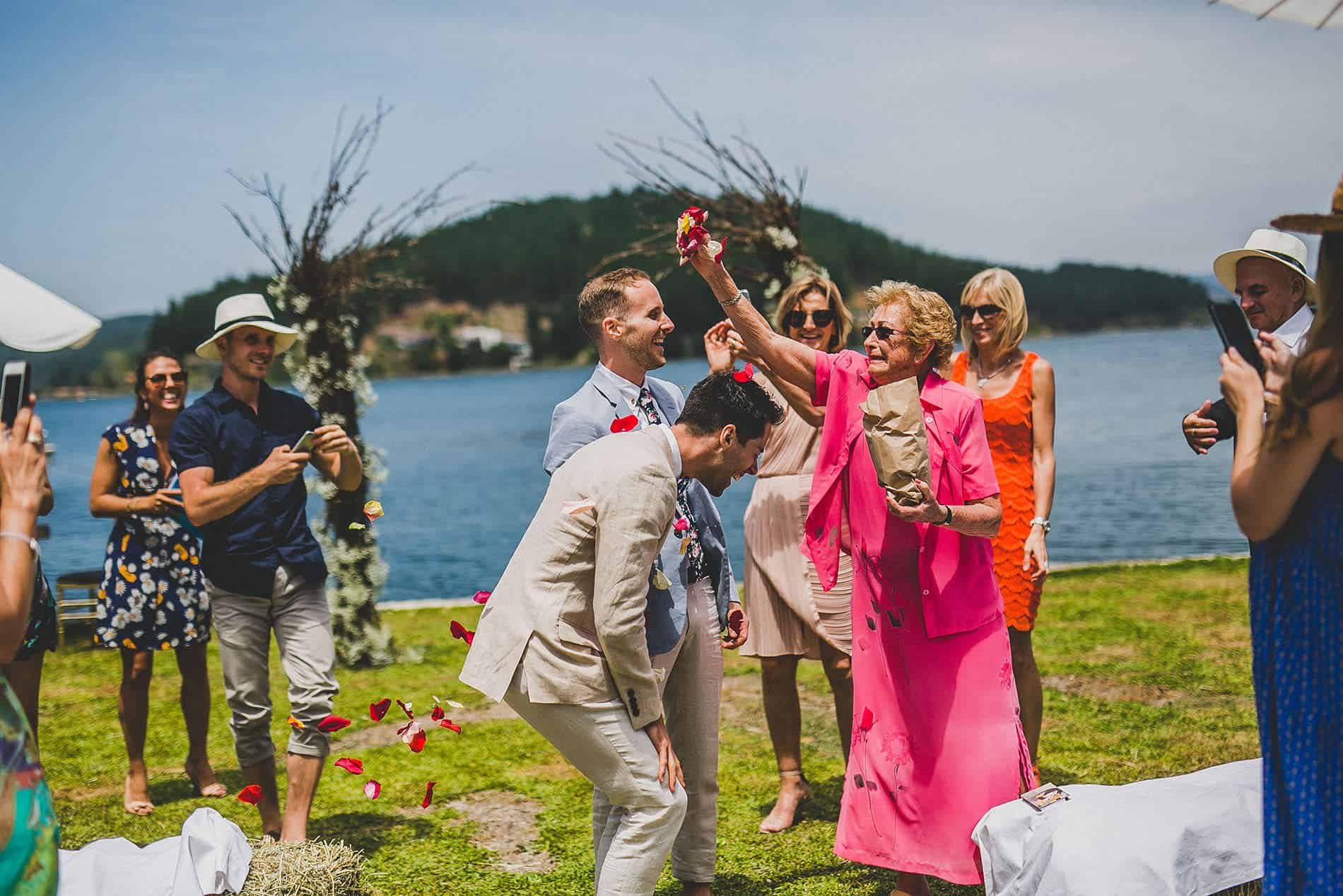 granma throws rose petals after the wedding ceremony