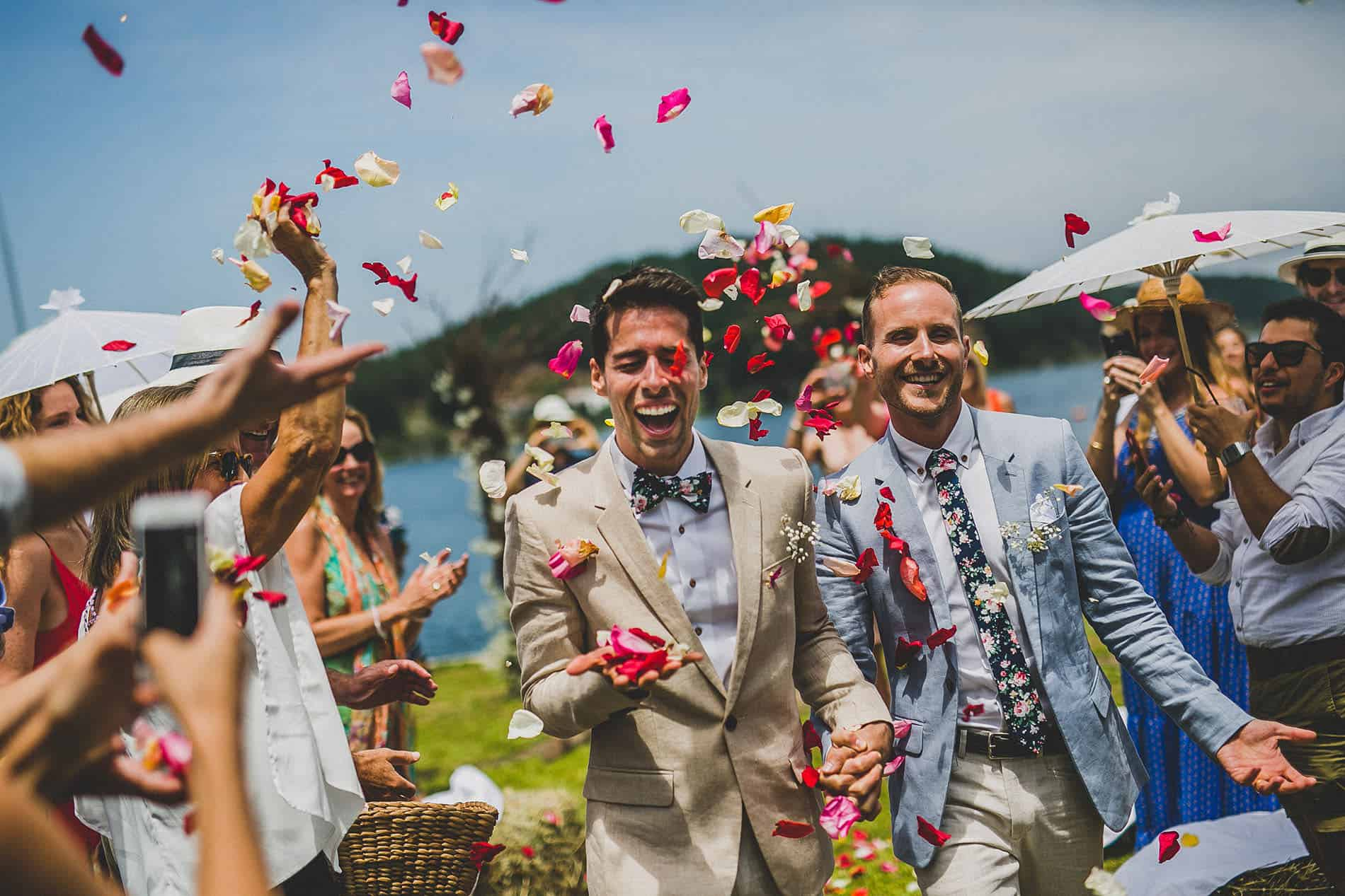 people throwing rose petals after the wedding ceremony