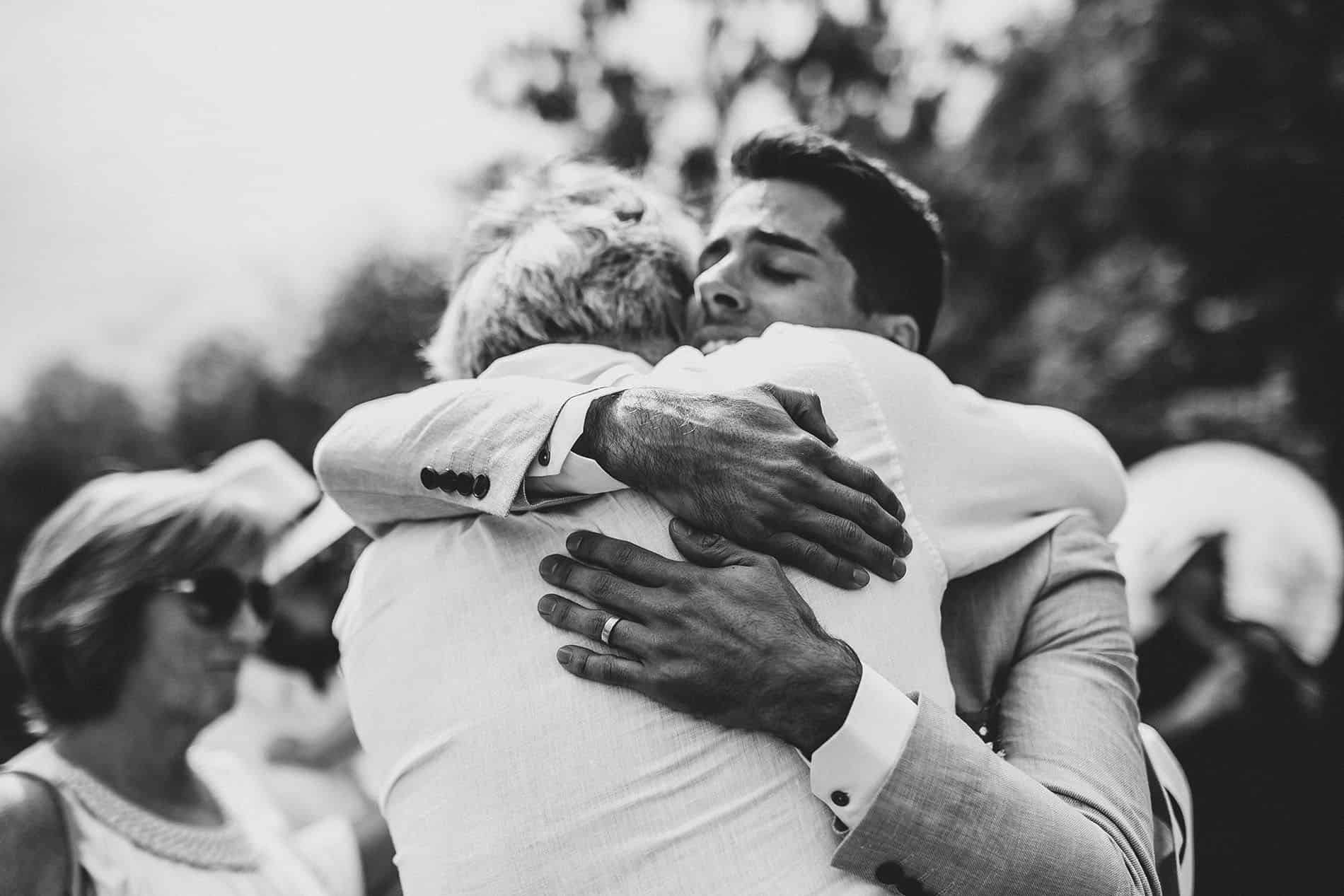 groom hugging a friend