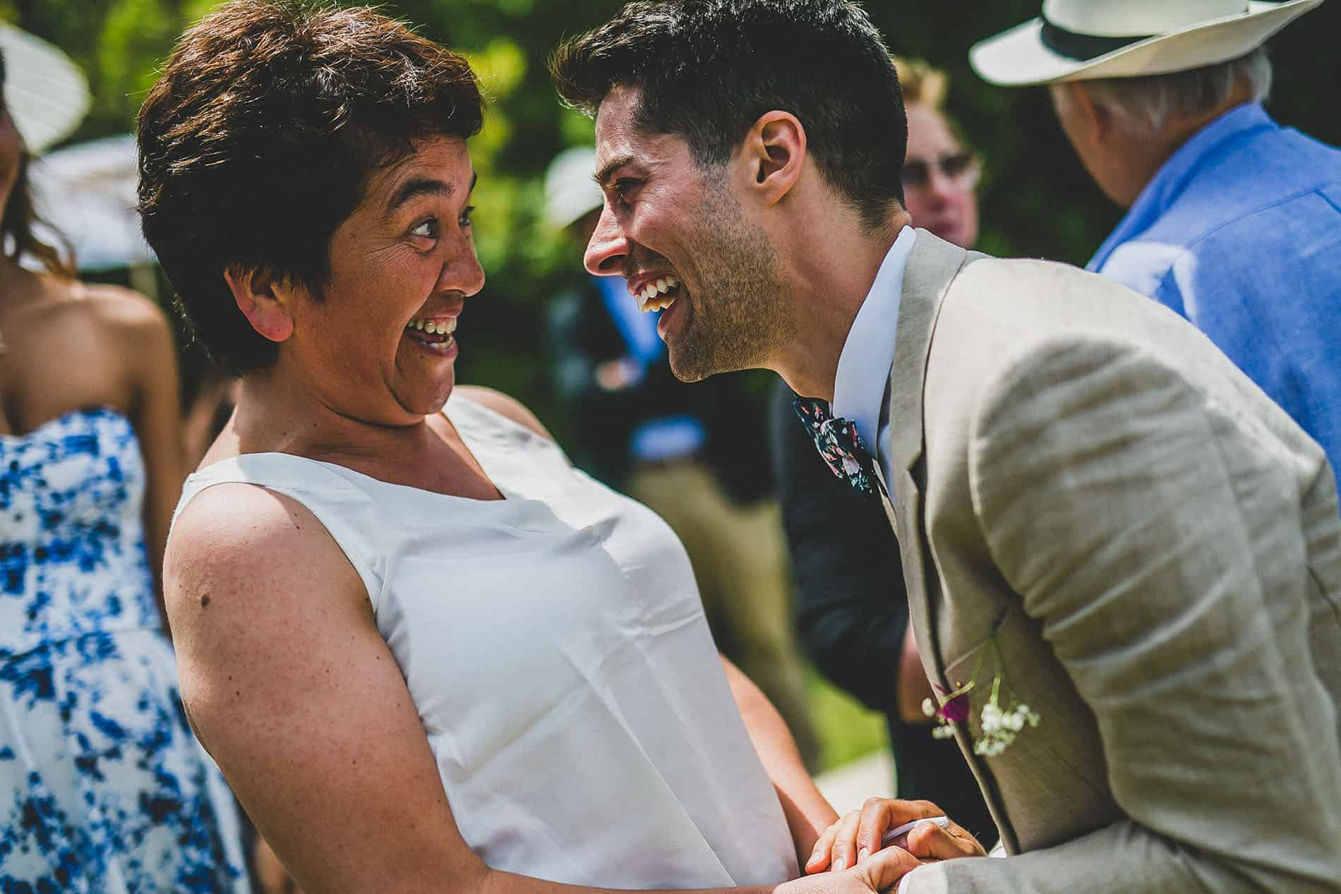groom laughing with a friend