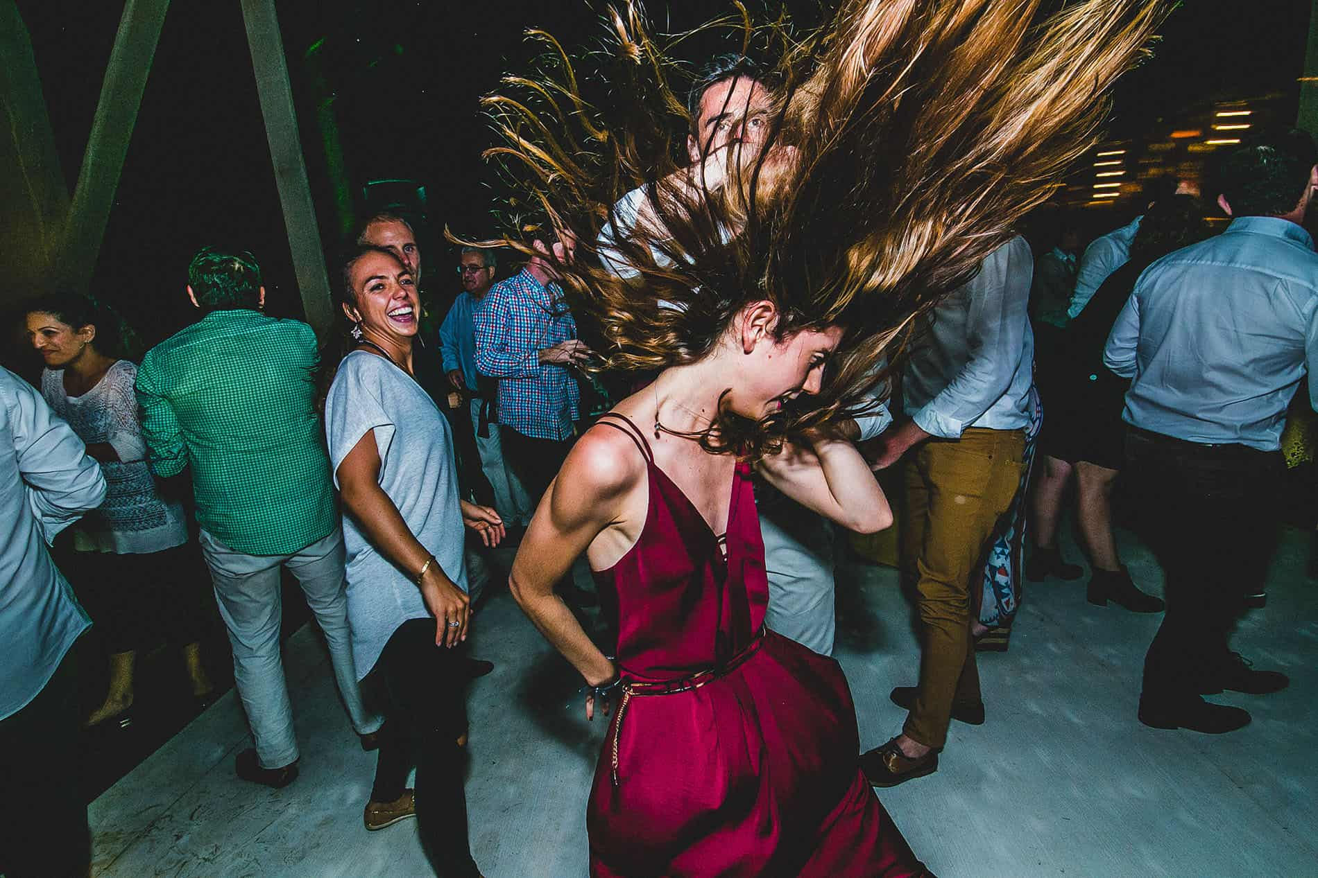 girl dancing with her hair in the wind in the wedding