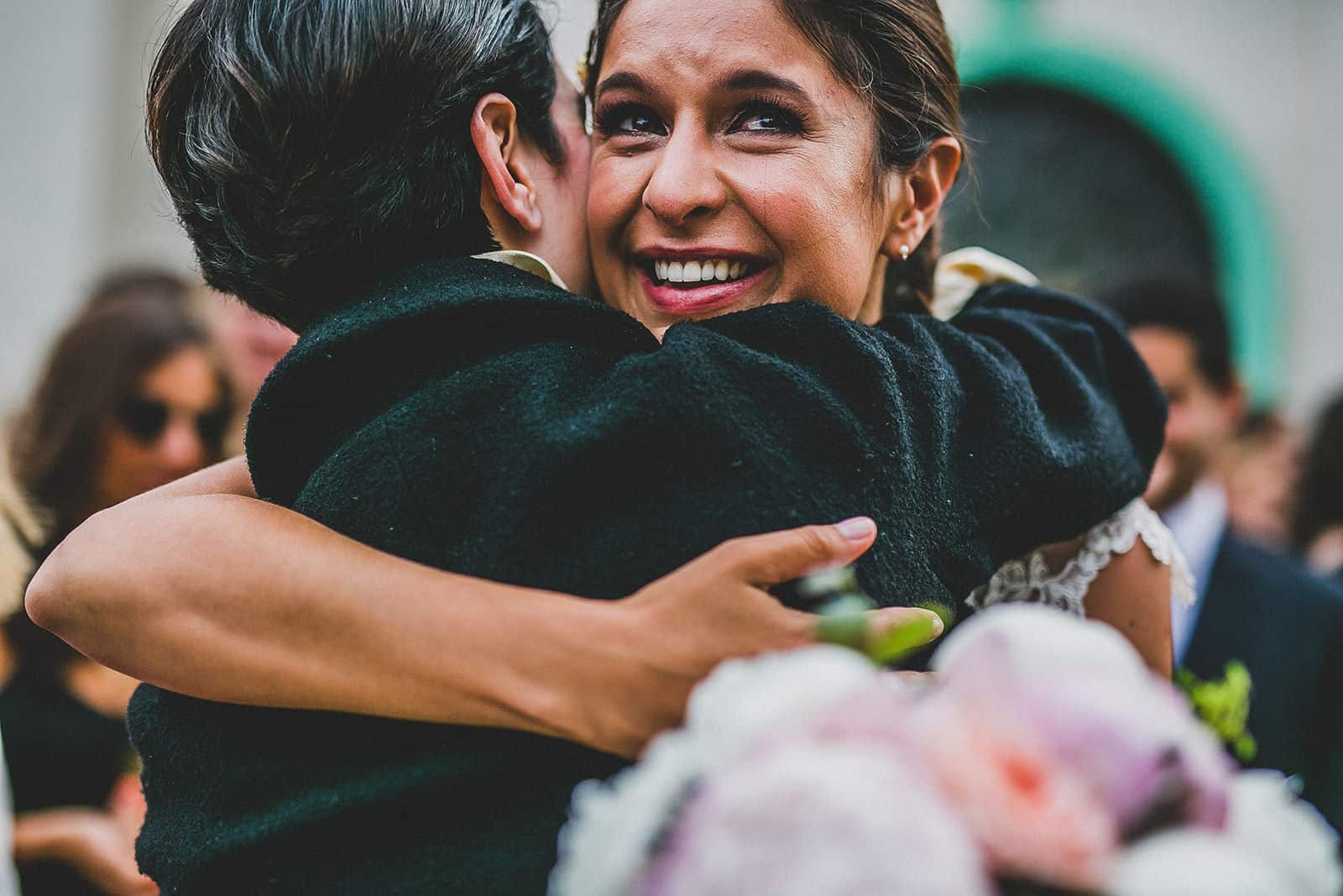 the bride hugging crying her friend in a wedding in barcelona