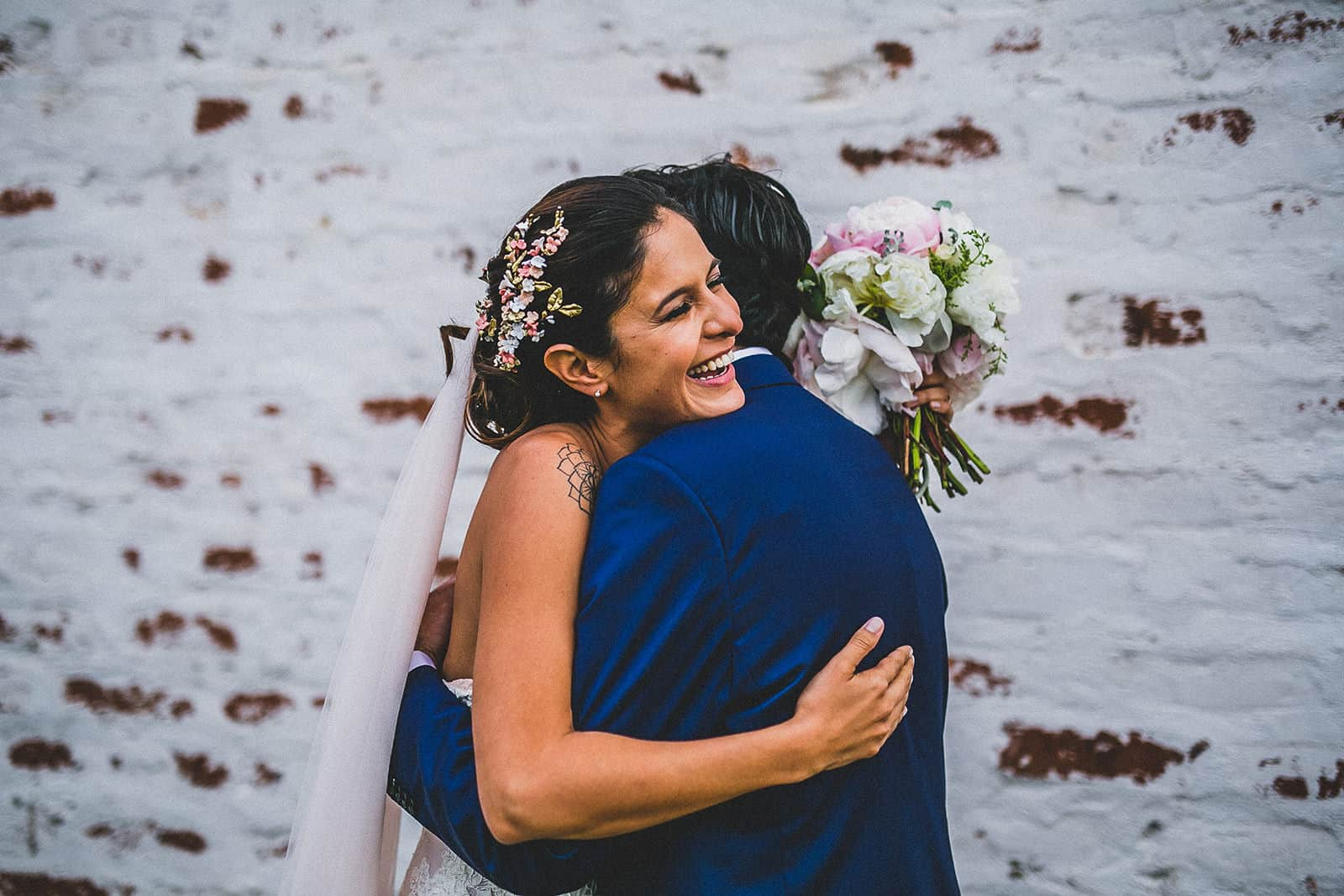 bride and groom hug each other in a wedding in barcelona
