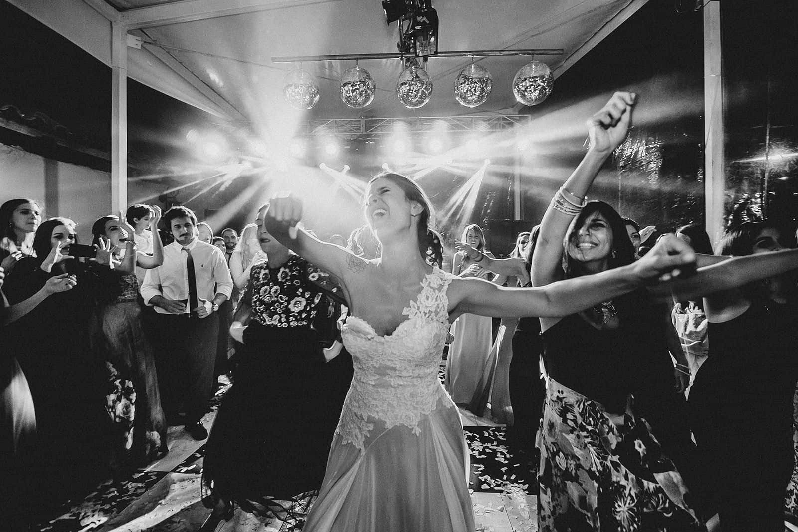 bride dancing with open arms in her wedding in barcelona
