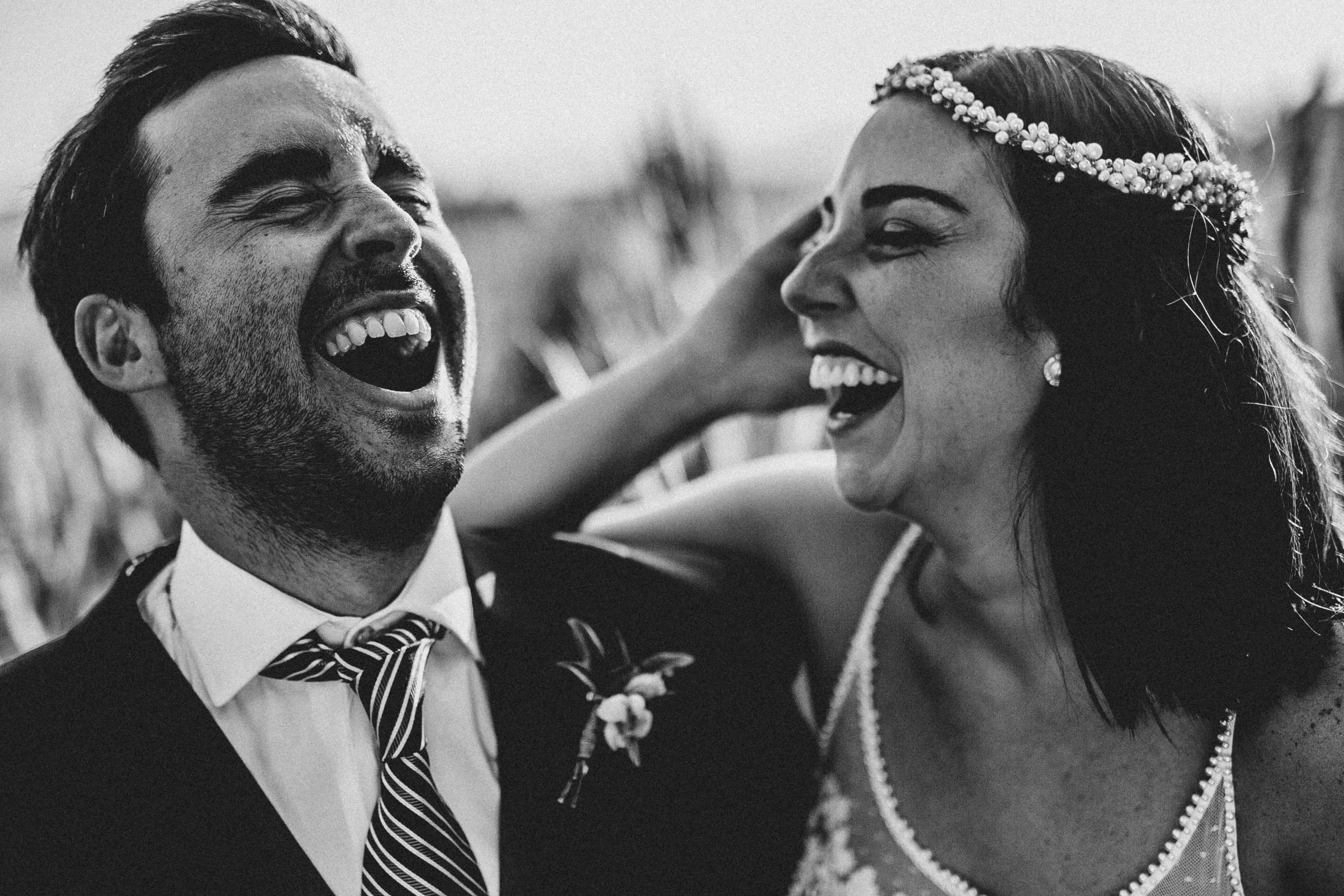 bride and groom laughing hard