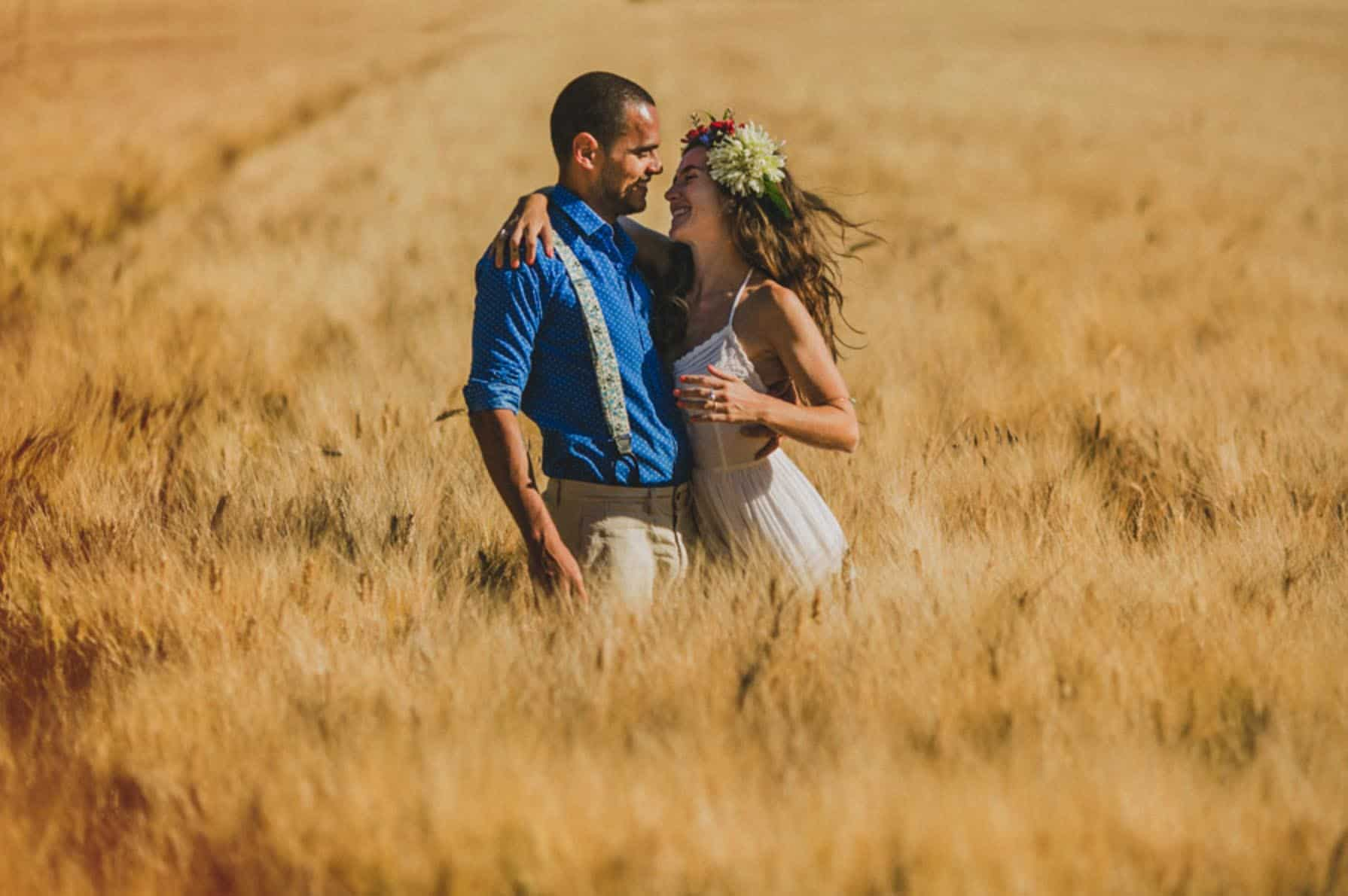 bride and groom in a field of yellow corn