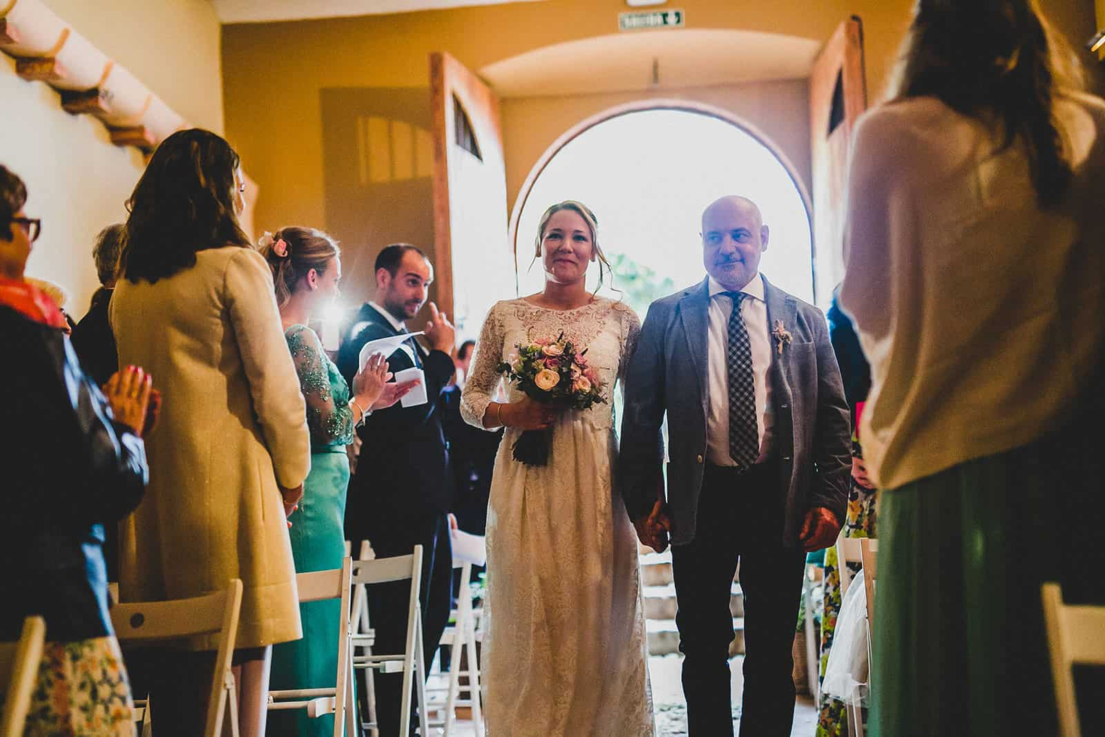 bride and her father enter in to the ceremony