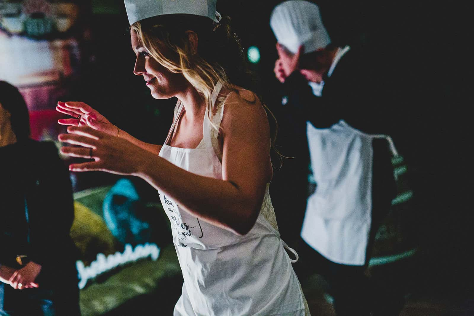 bride and groom playing as cooks