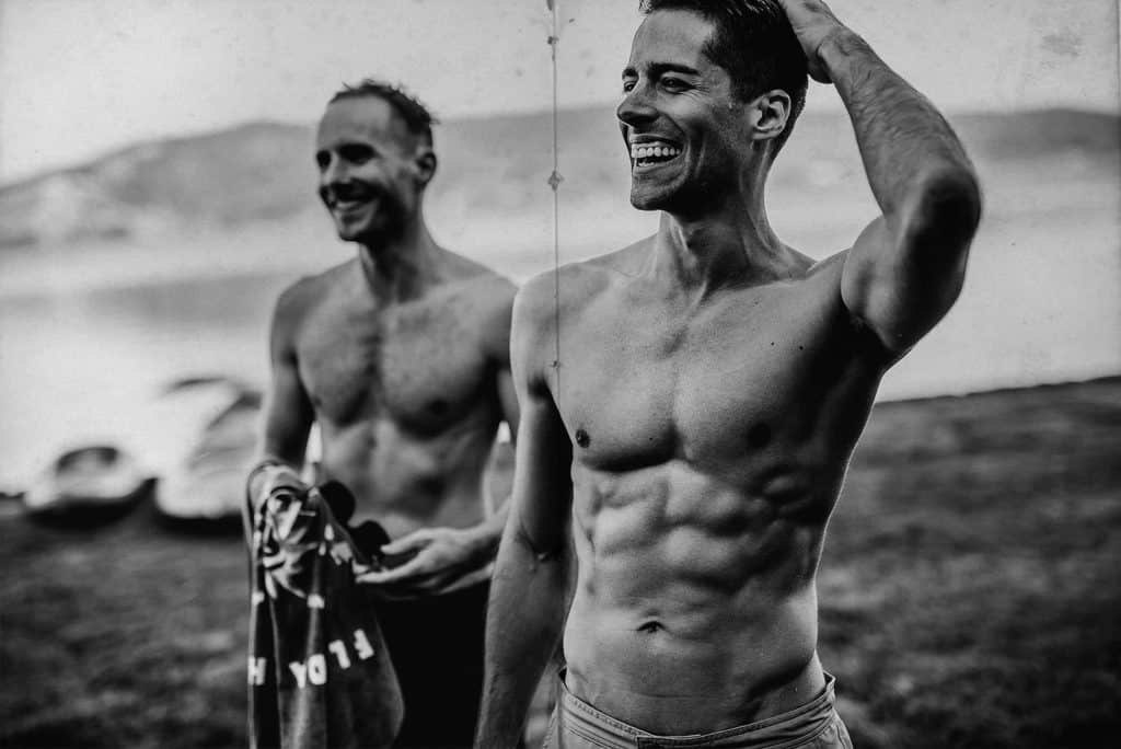two sexy grooms without t shirt in a lake