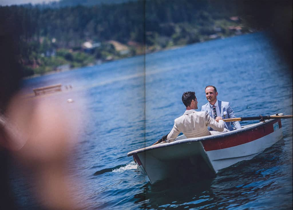 same sex couple arriving to the ceremony by boat