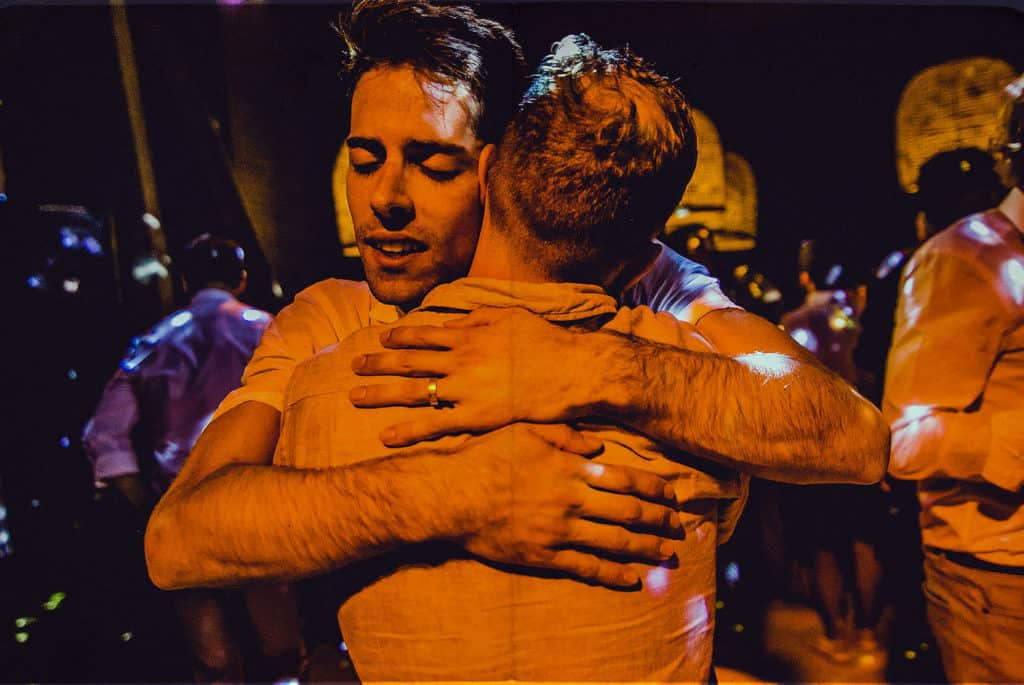 same sex couple hugging each other on the dance floor