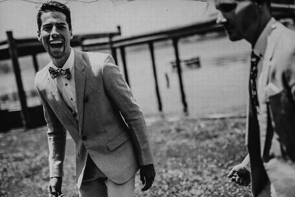 groom and groom laughing