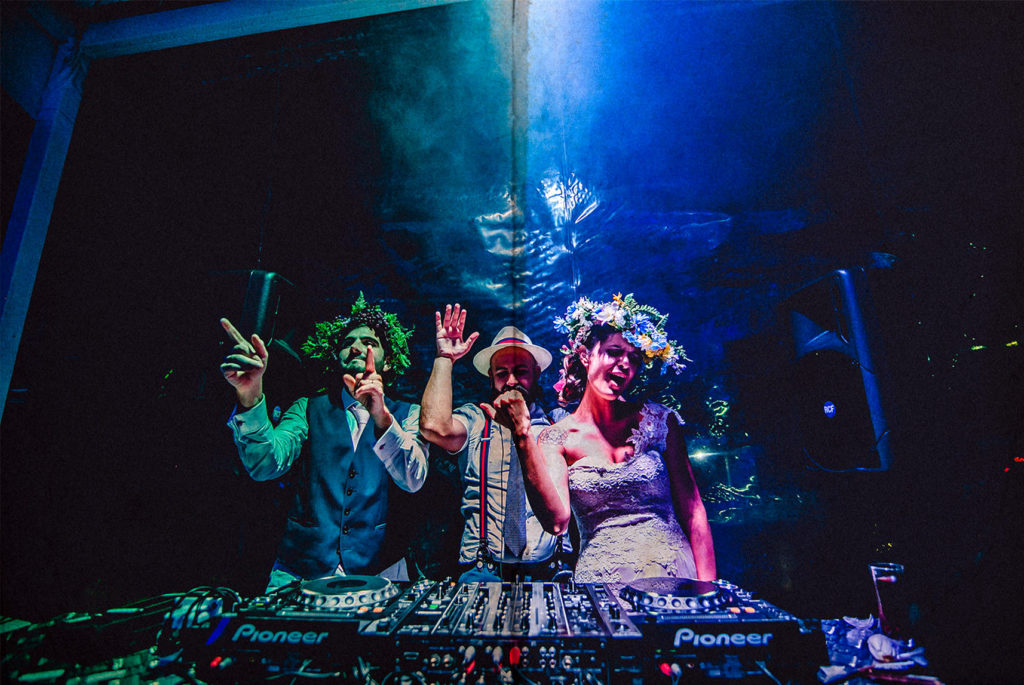 bride and groom playing with the dj