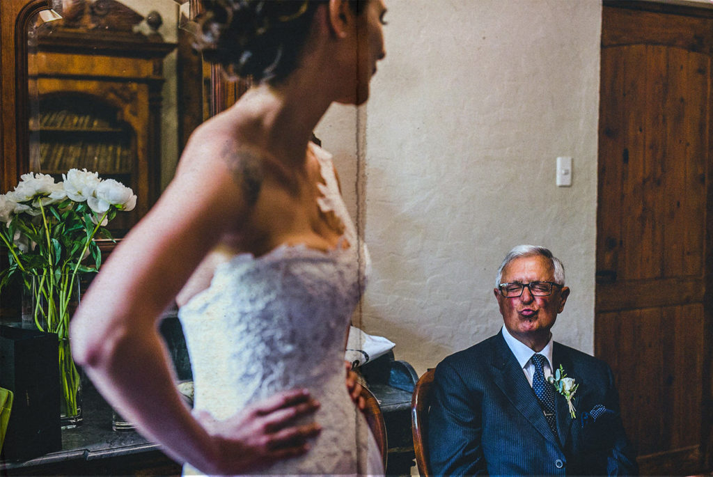 dad throws a kiss to the bride