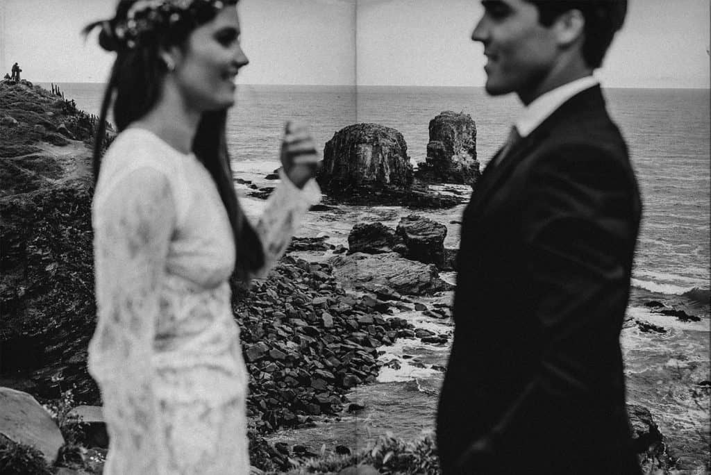 bride and groom face to face blurry in a cliff