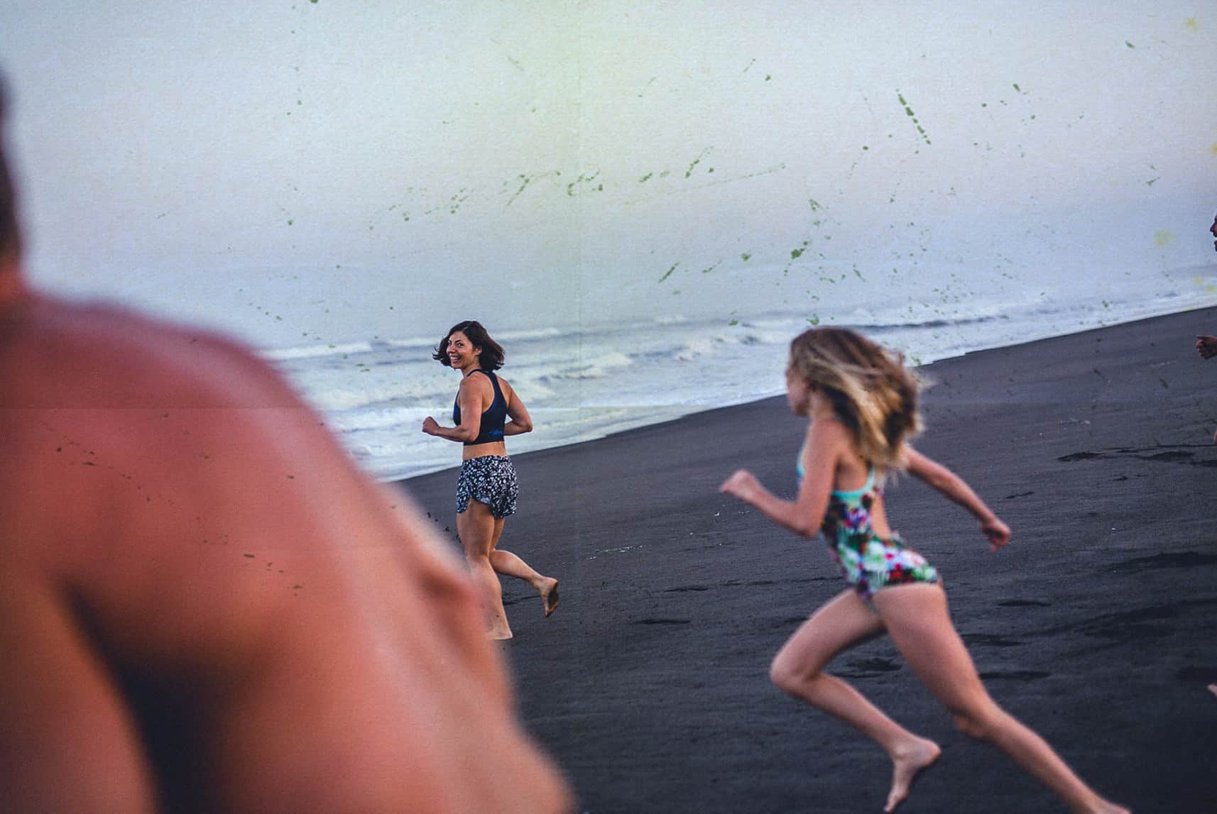 people running to the sea