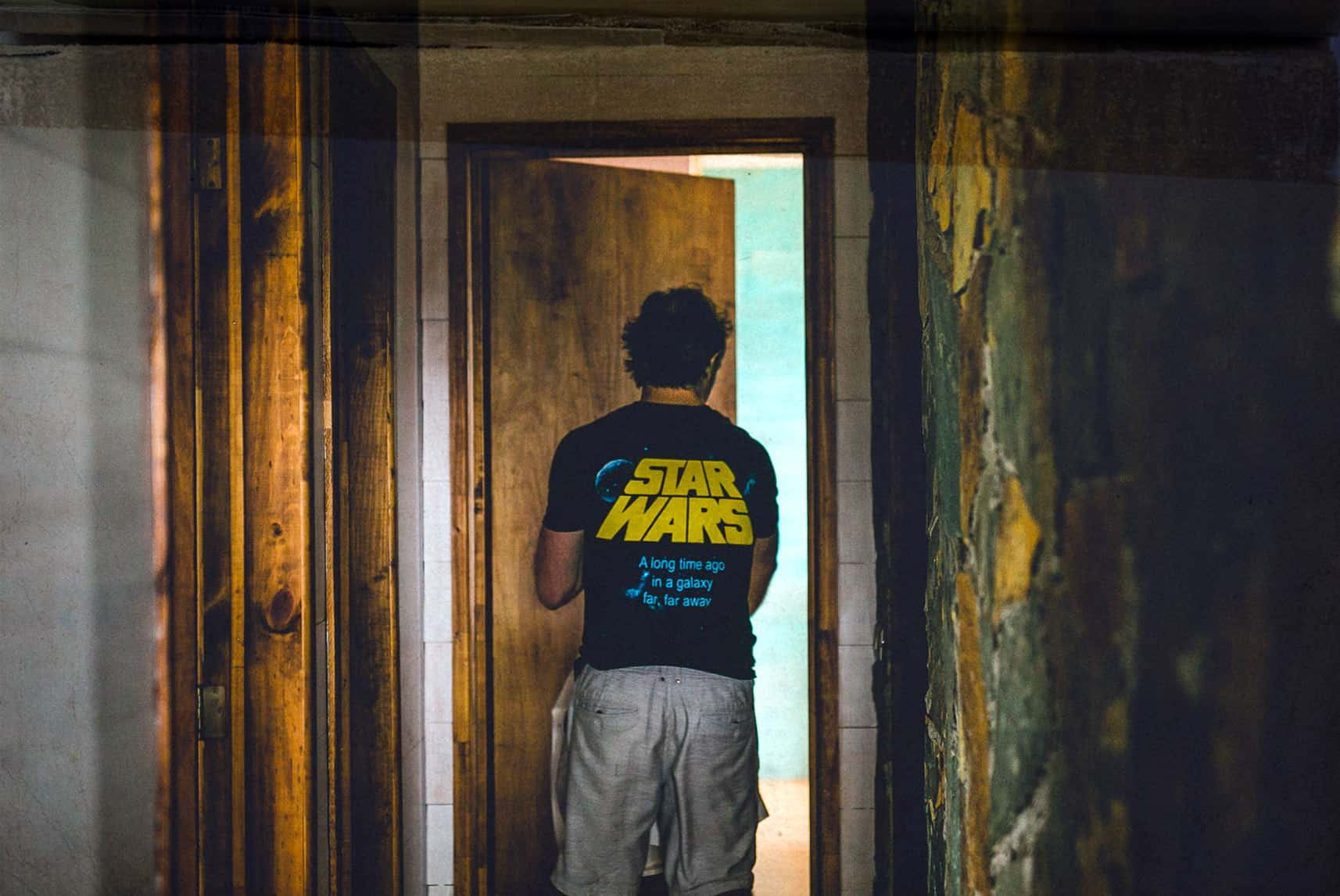 a groom with star wars t shirt walked in his room