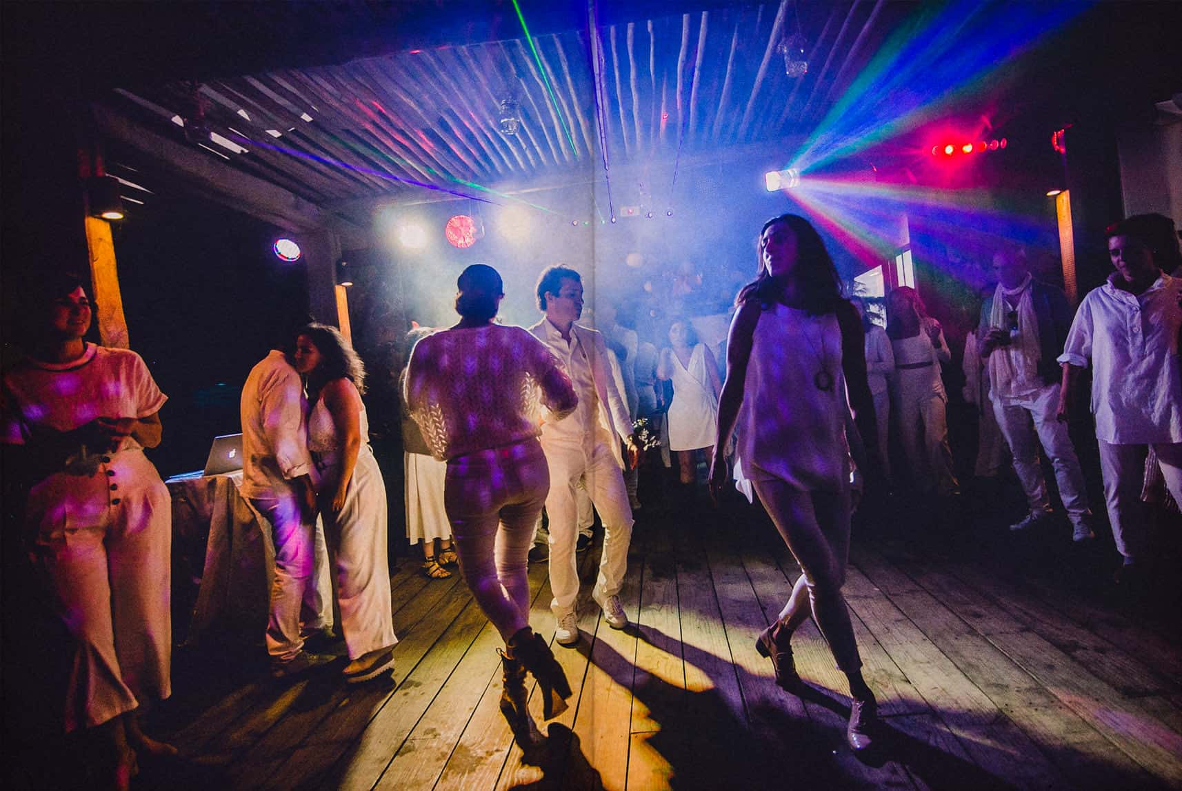 people dancing against the light in the dance floor