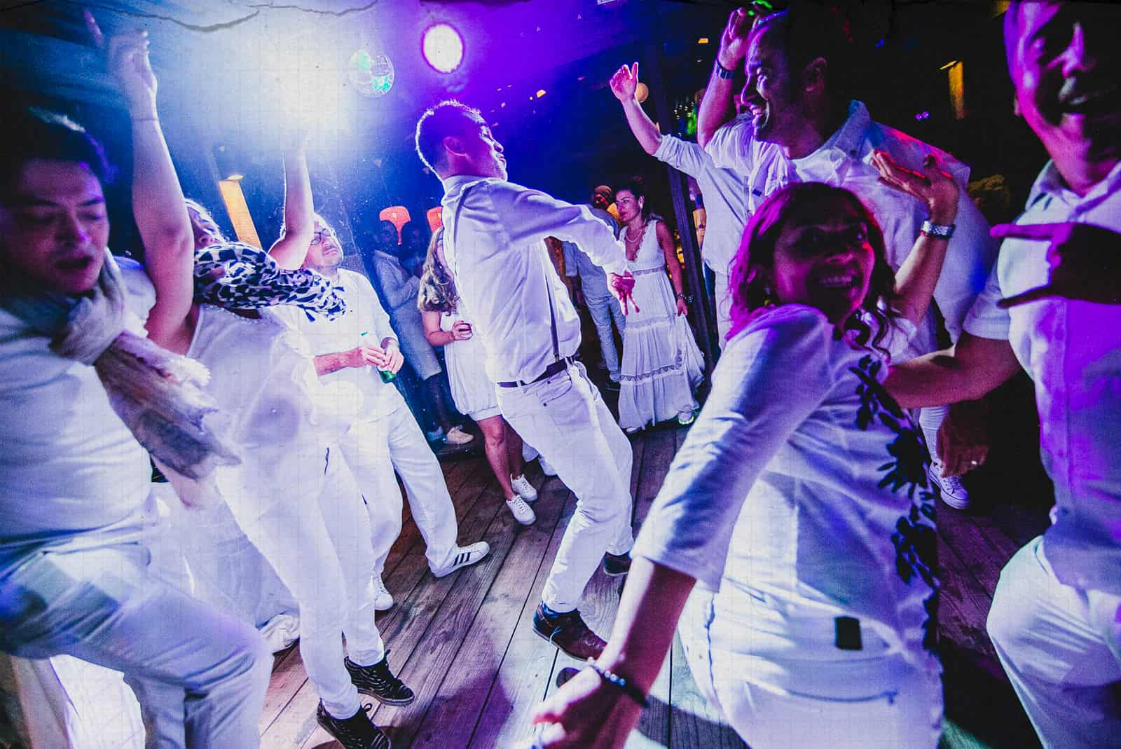 people dancing wildly in a sydney wedding