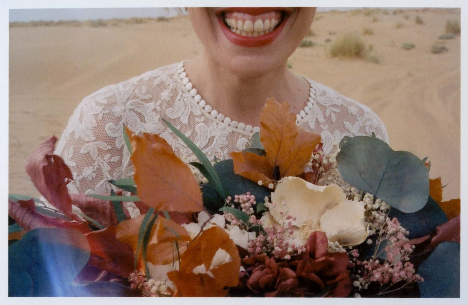 an amazing smile of a bride with flowers bouquet