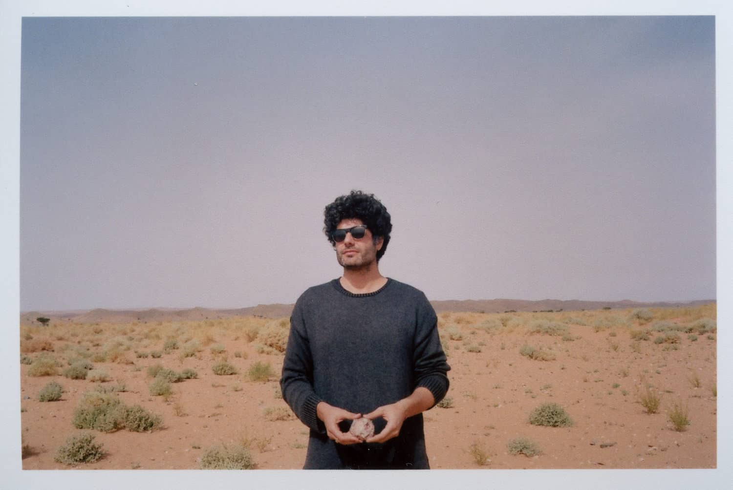 gorgeous man looking at infinity in the desert