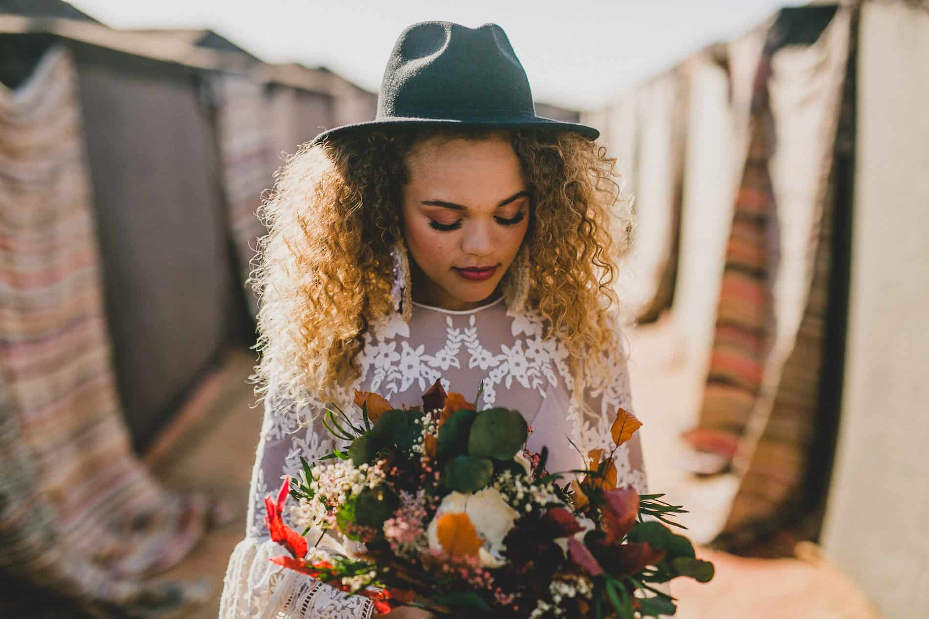 model with bridal dress in a berber tent getting ready for a shoot in a wedding photography workshop