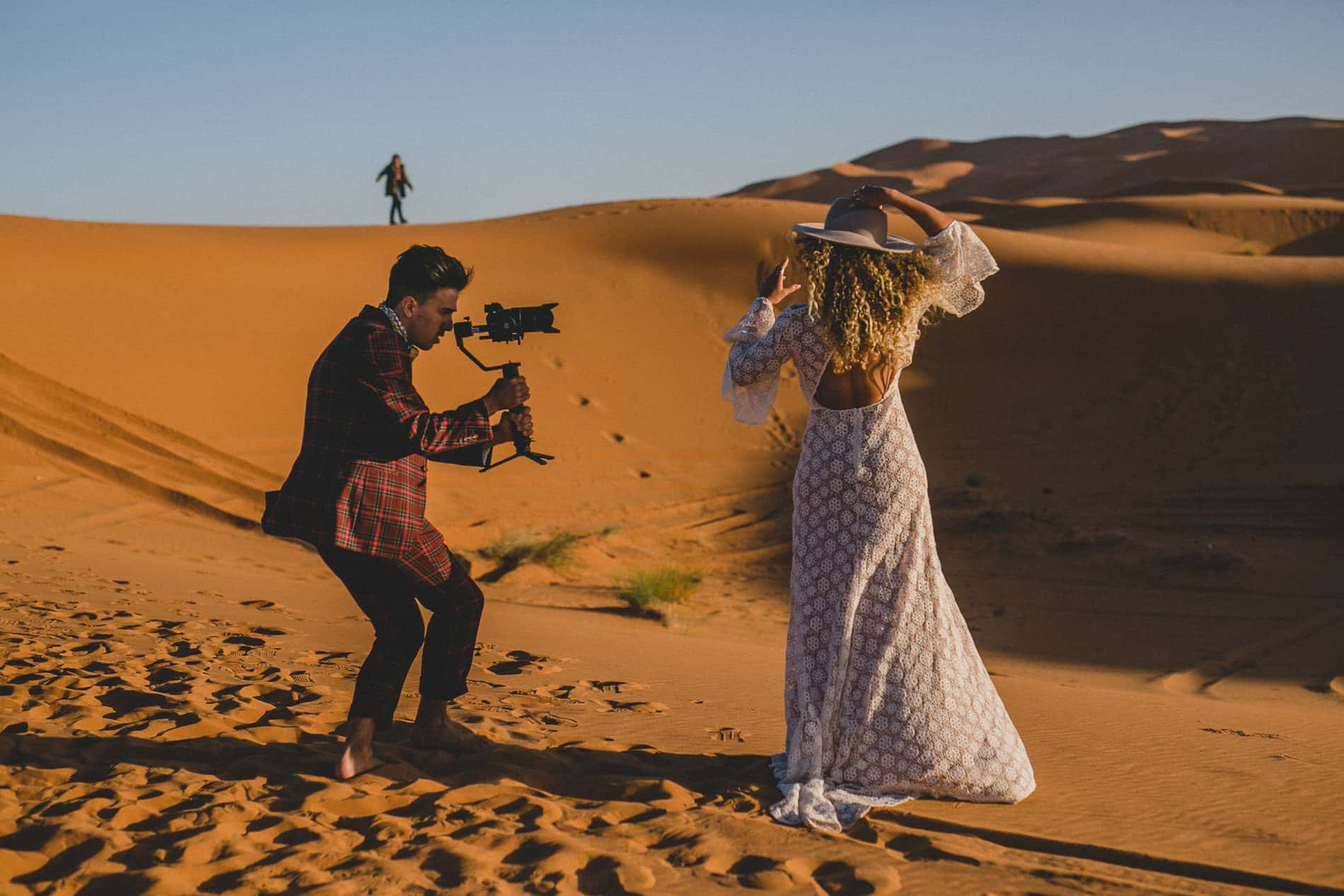 videographer record a bride in the middle of morrocan desert