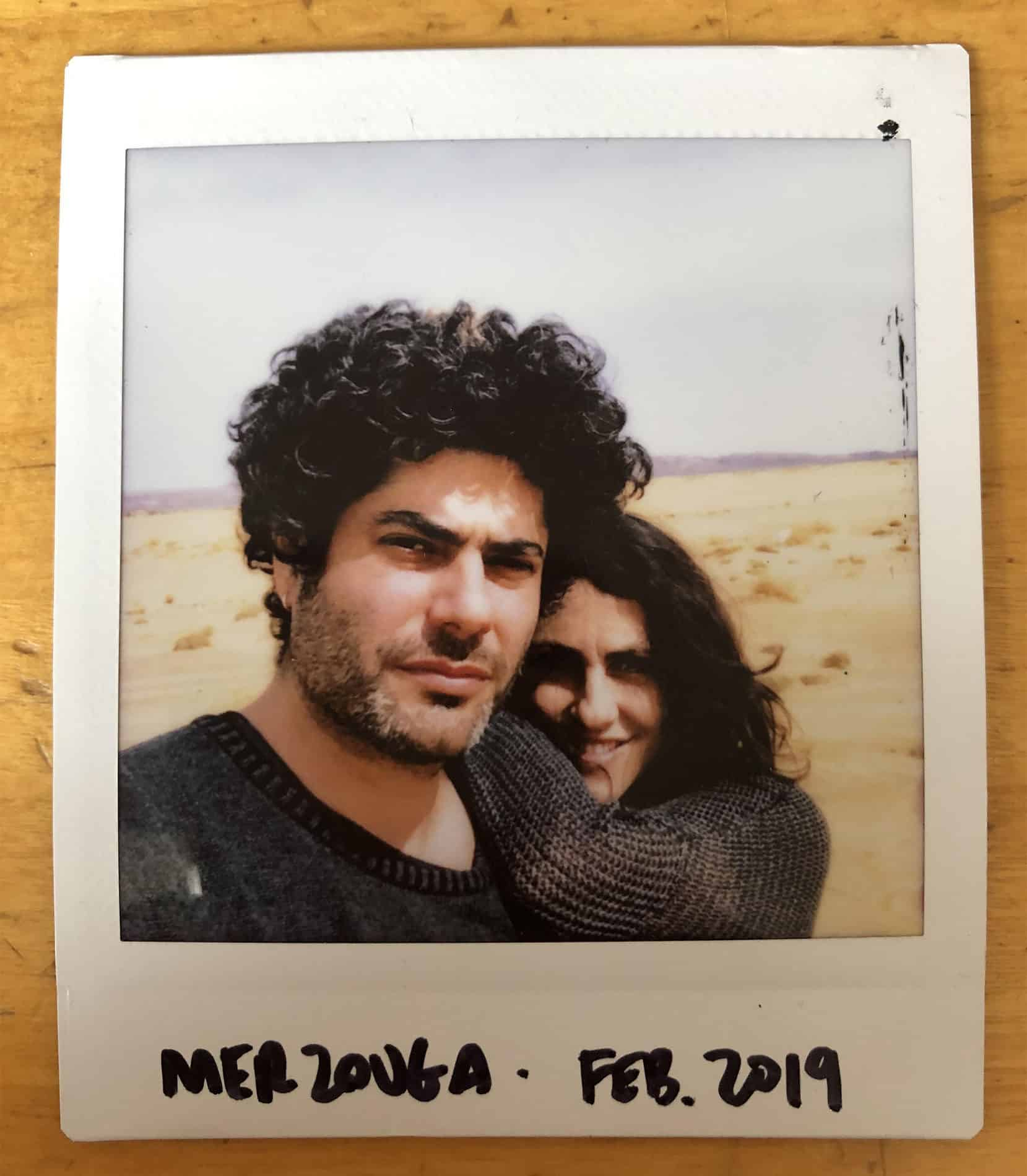 polaroid portrait of a man and his girl