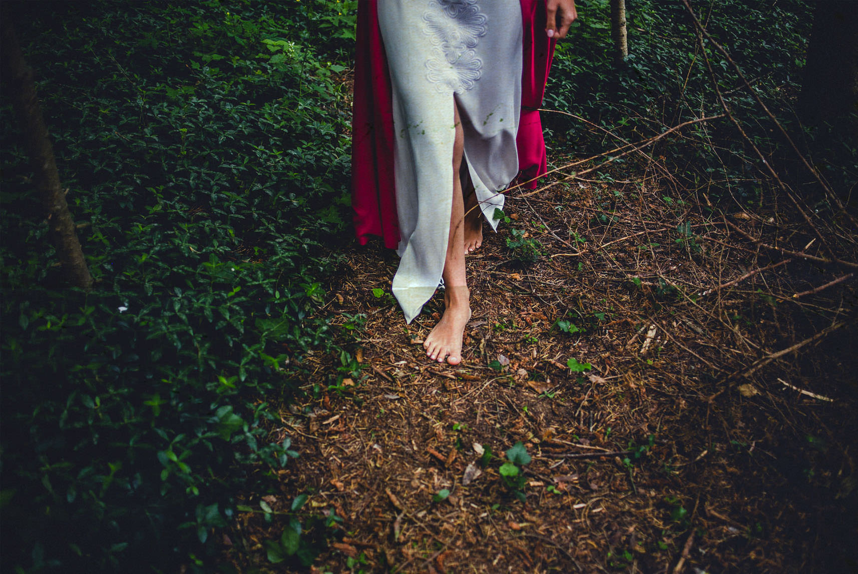 bride walking in the wood barefoot