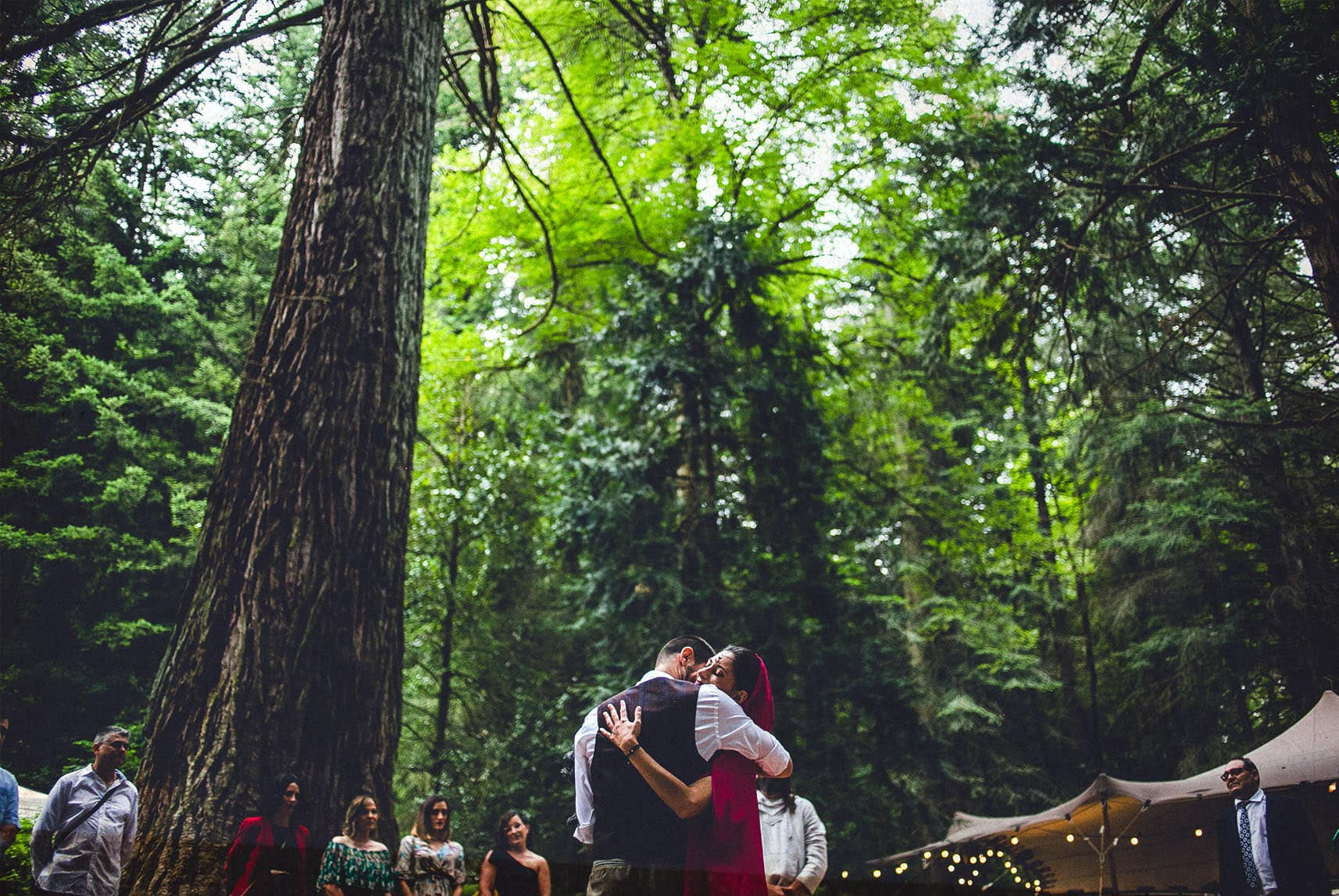 bride and groom hug each other in their ceremony