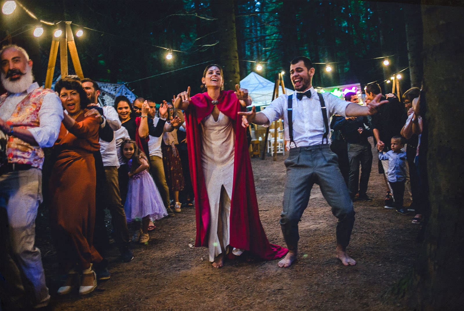 bride and groom dancing in the forrest