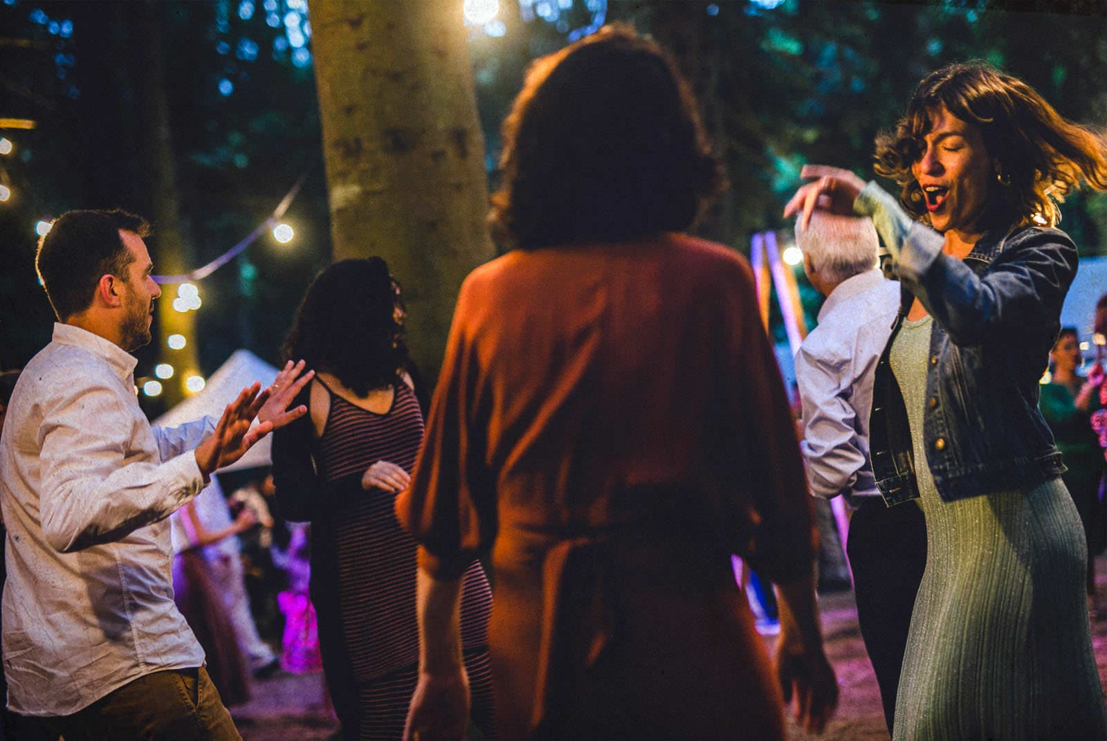 people dancing in the forrest