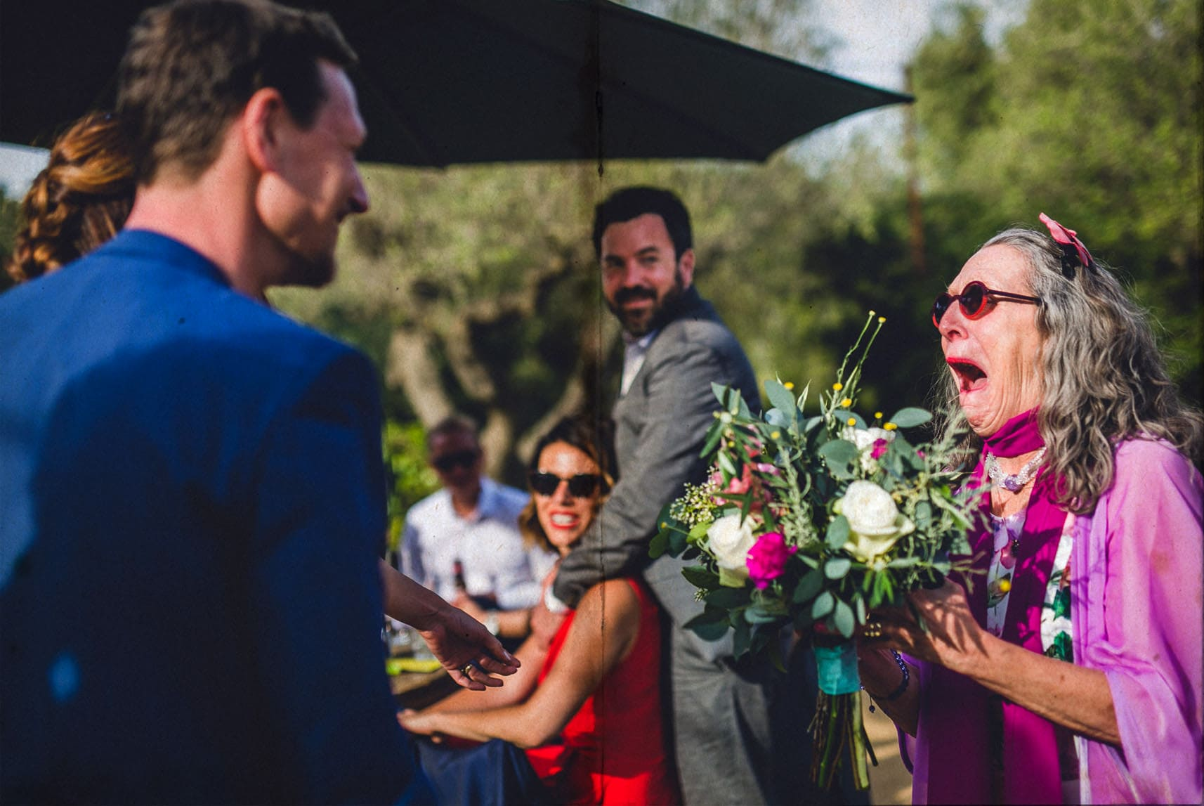 bride and groom delivered a bouquet to the mother of the groom