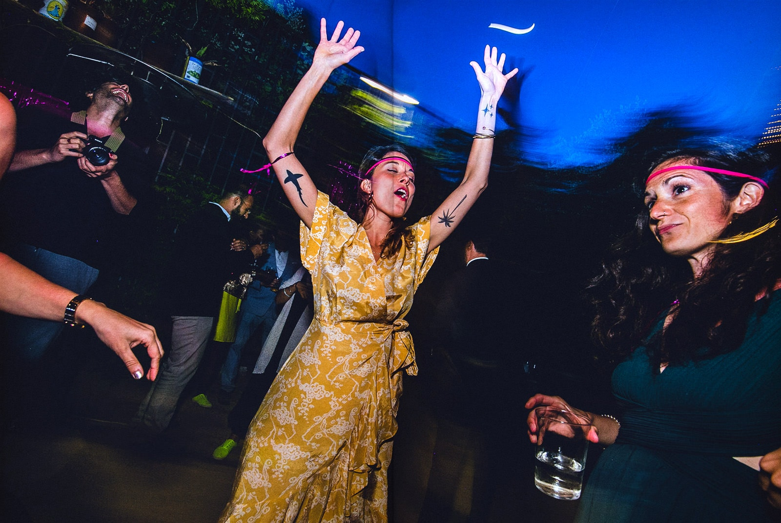 people dancing like crazy at a wedding in barcelona