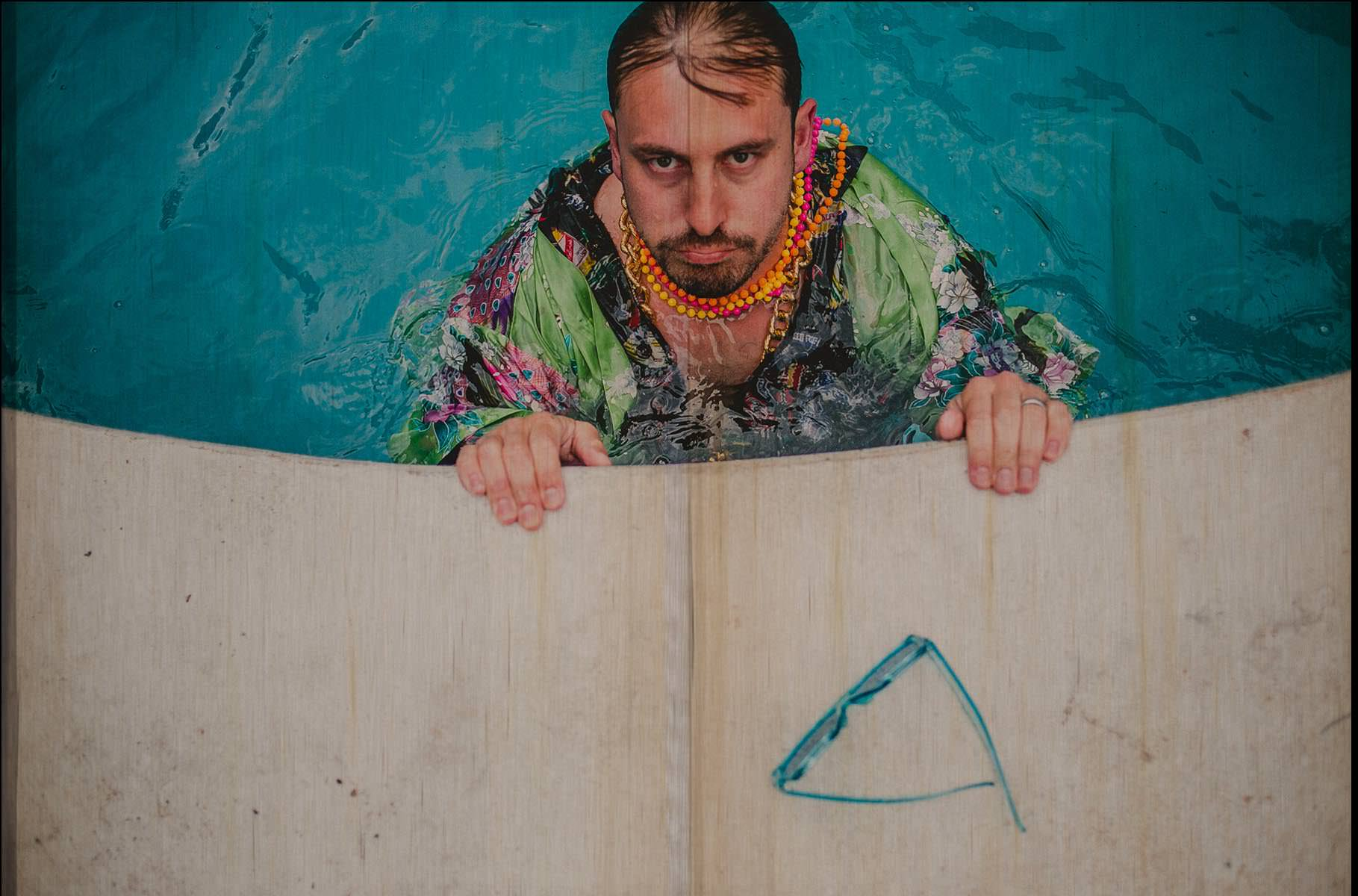 groom in a pool with cloth tired!