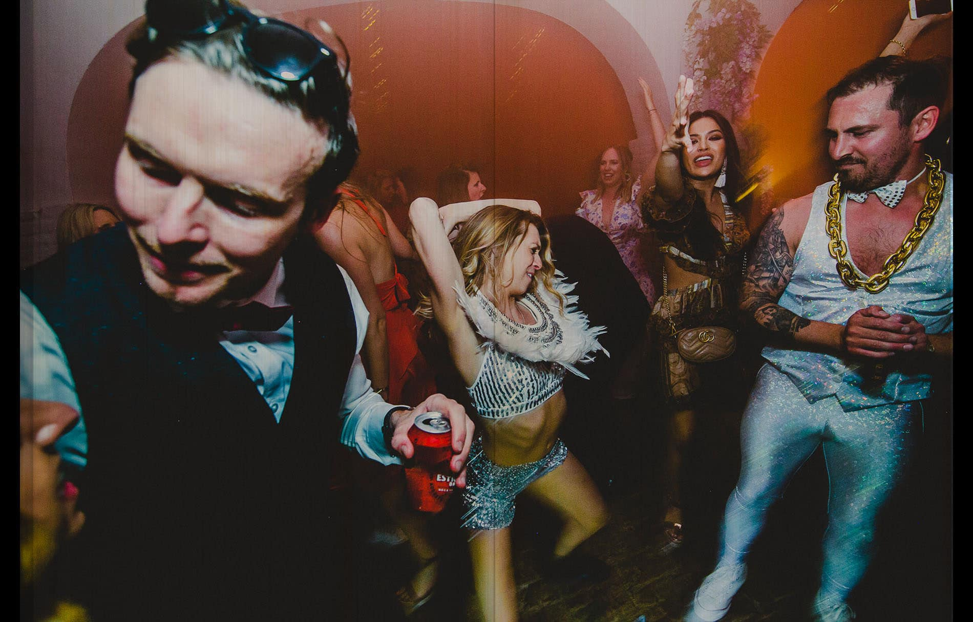 bride and groom dancing like crazy in a wild wedding party