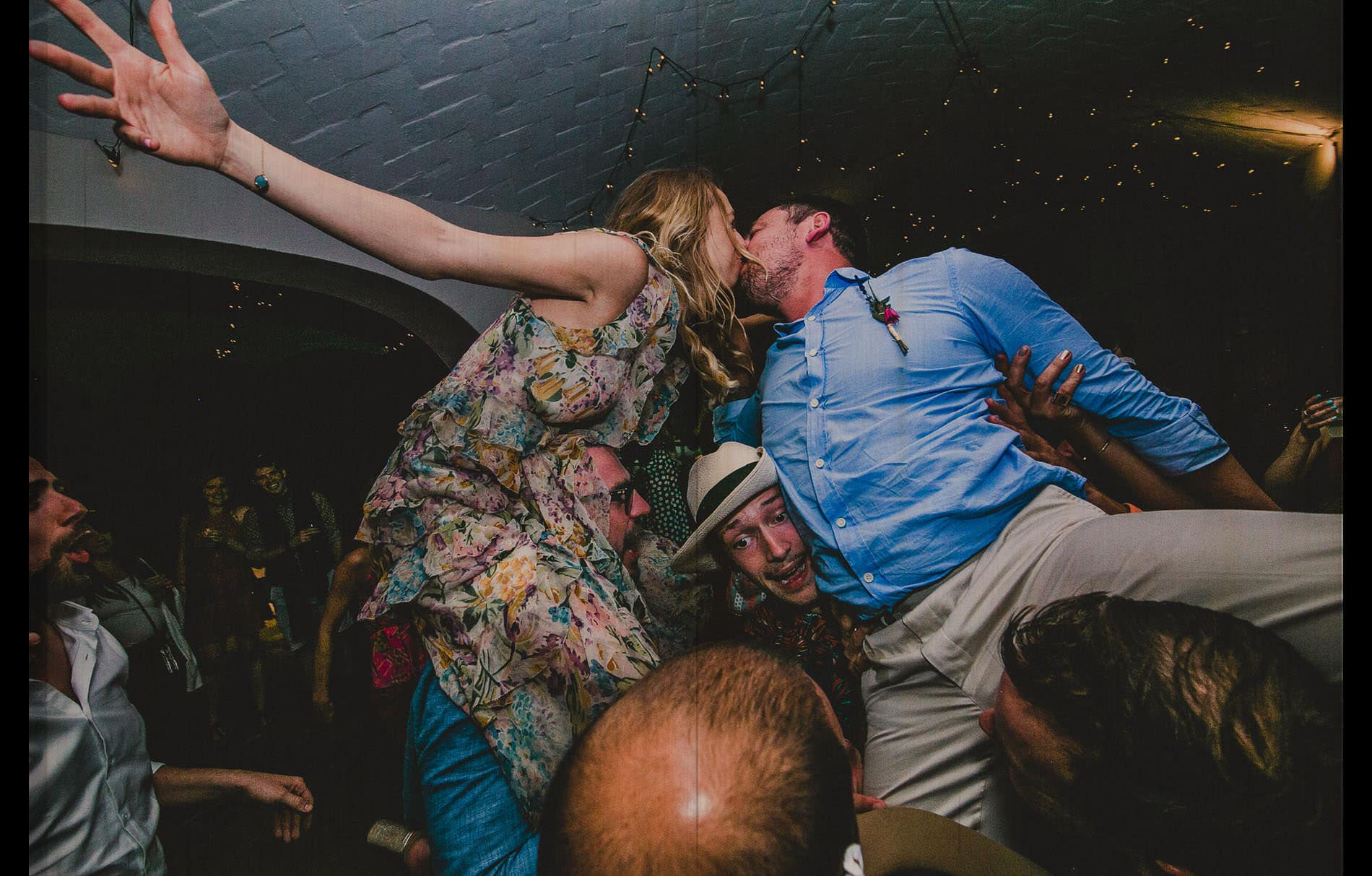 bride and groom kissing each other in the air