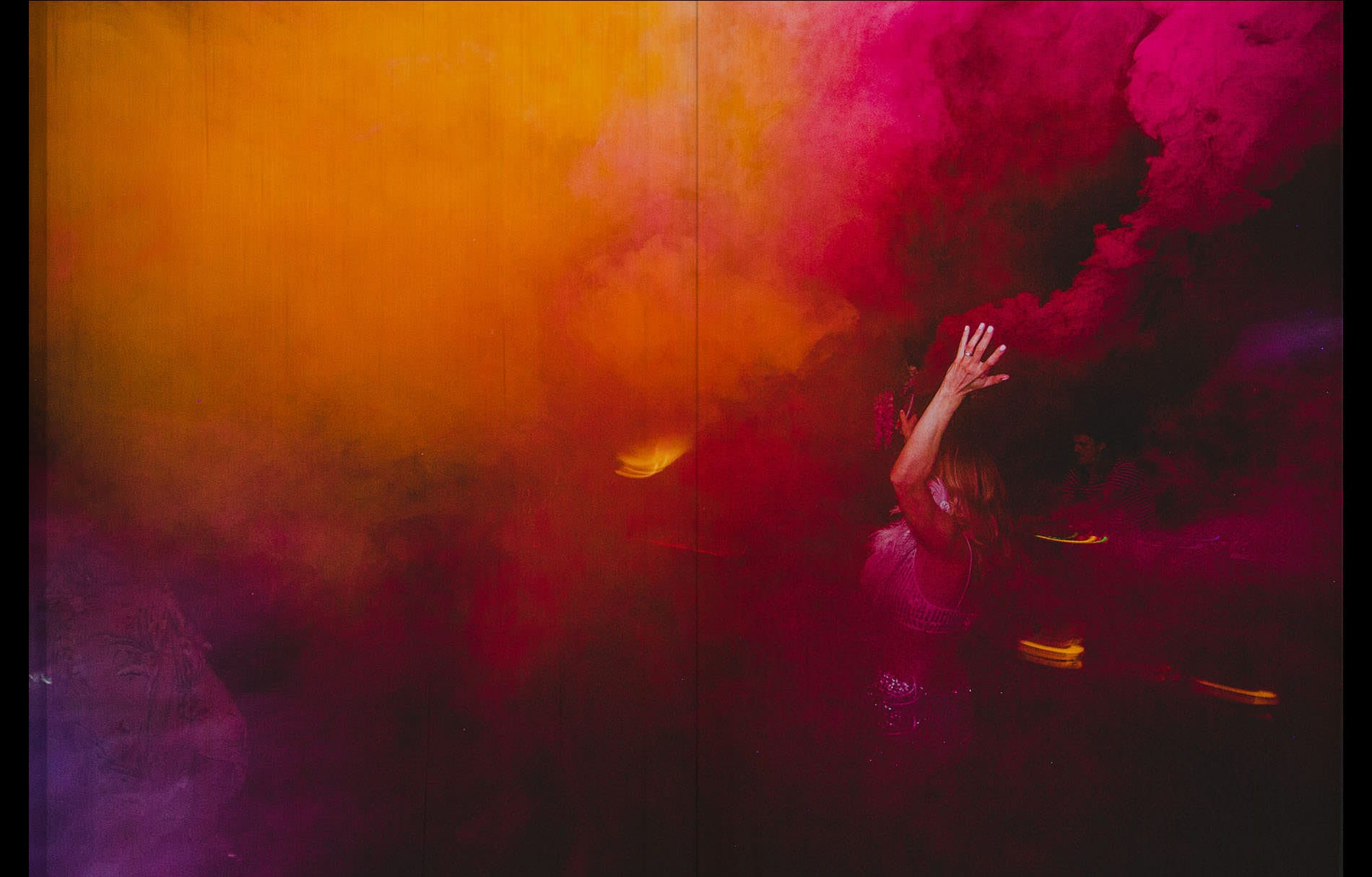 bride hand throwing smoke bomb at the party