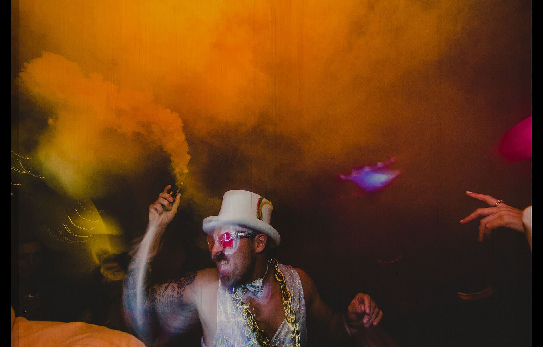 groom with shinny custom throwing smoke bomb at the party