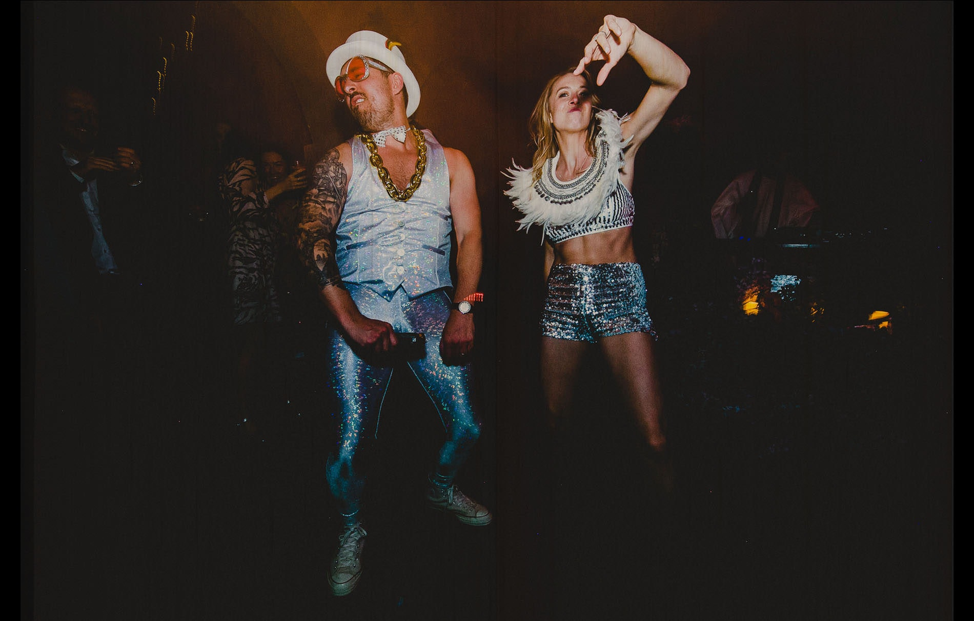bride and groom with customs dancing like crazy people