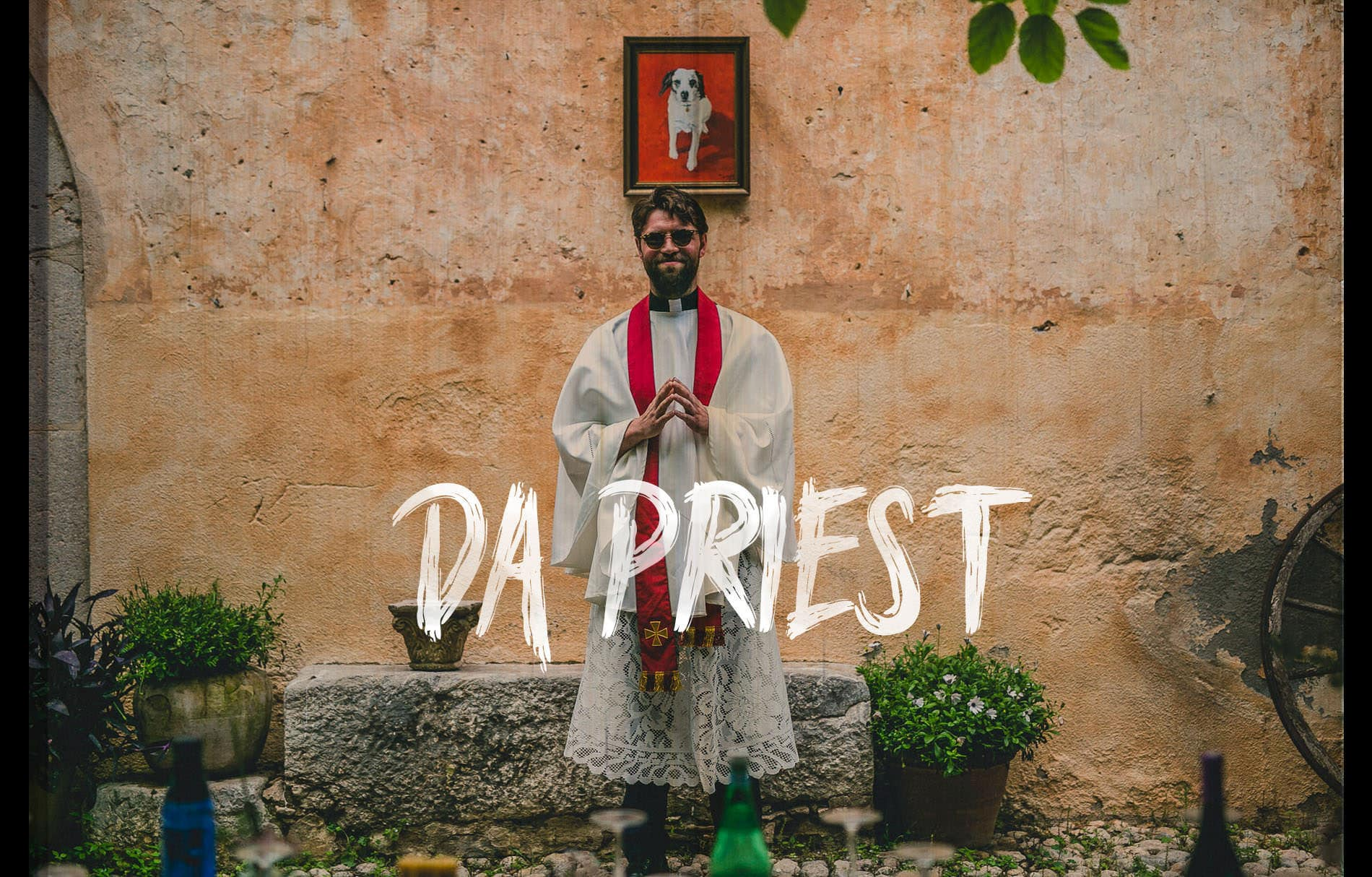 a friend dresses as a priest