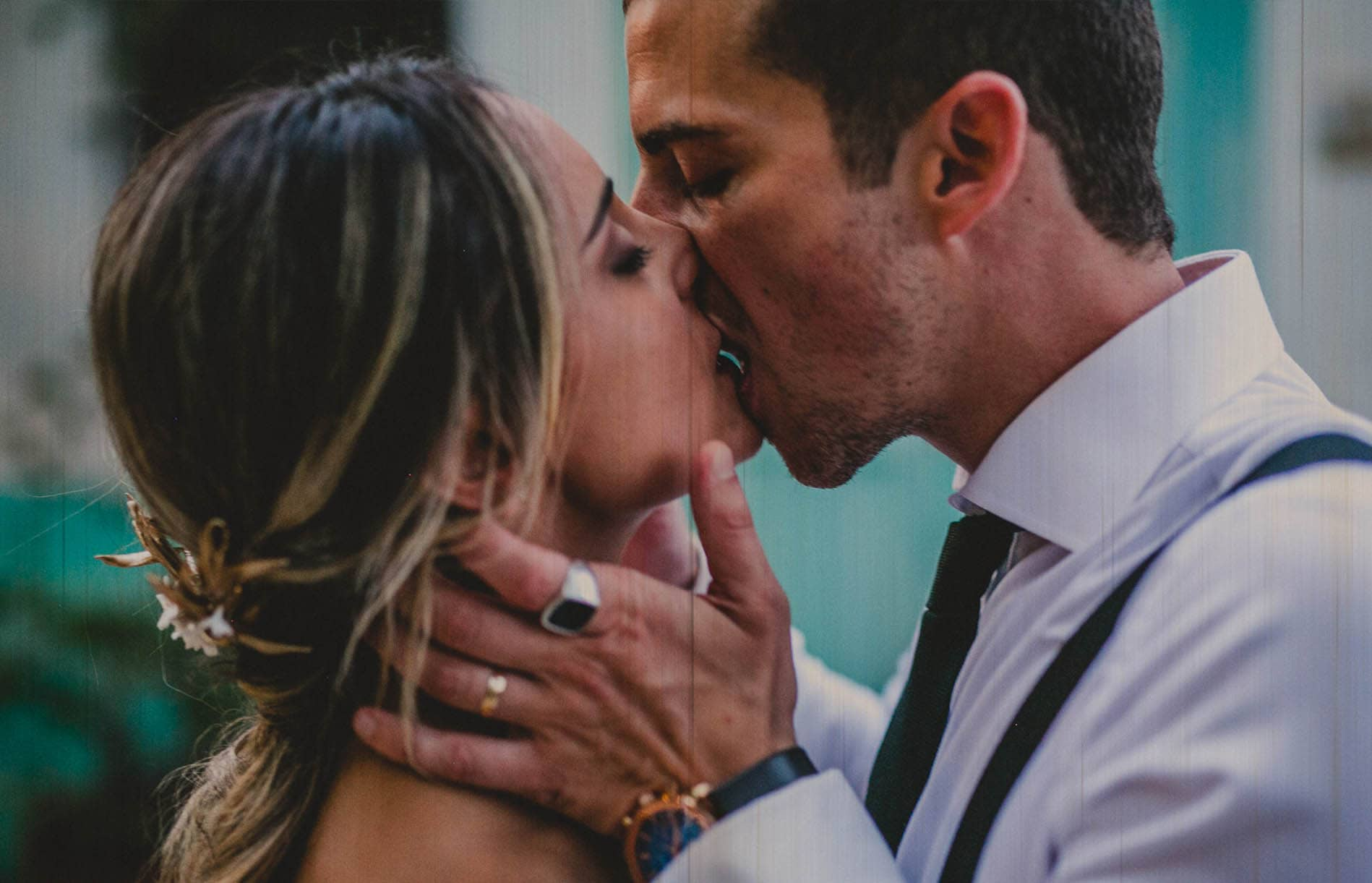 bride and groom kissing with passion