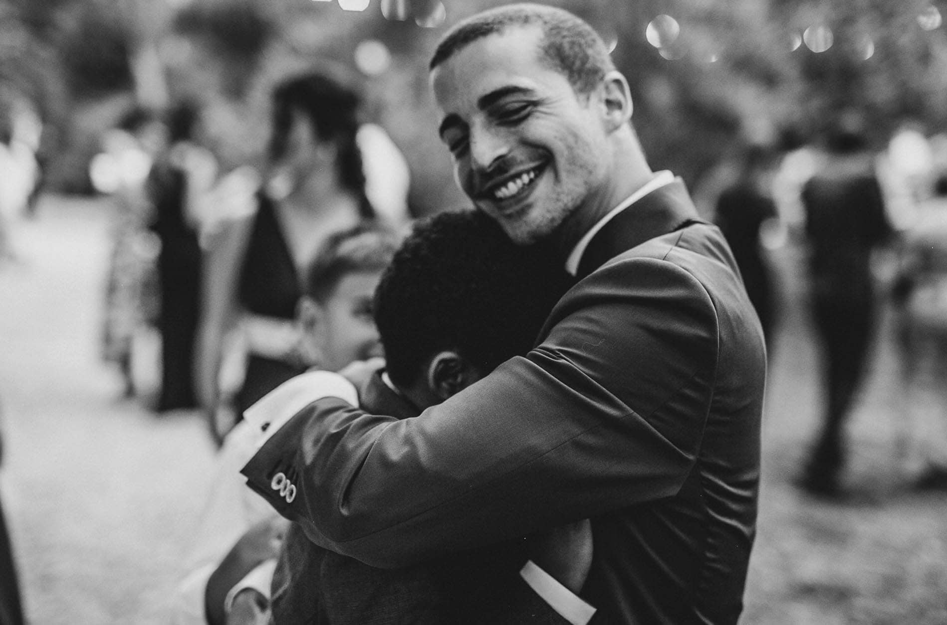 groom hugs his son